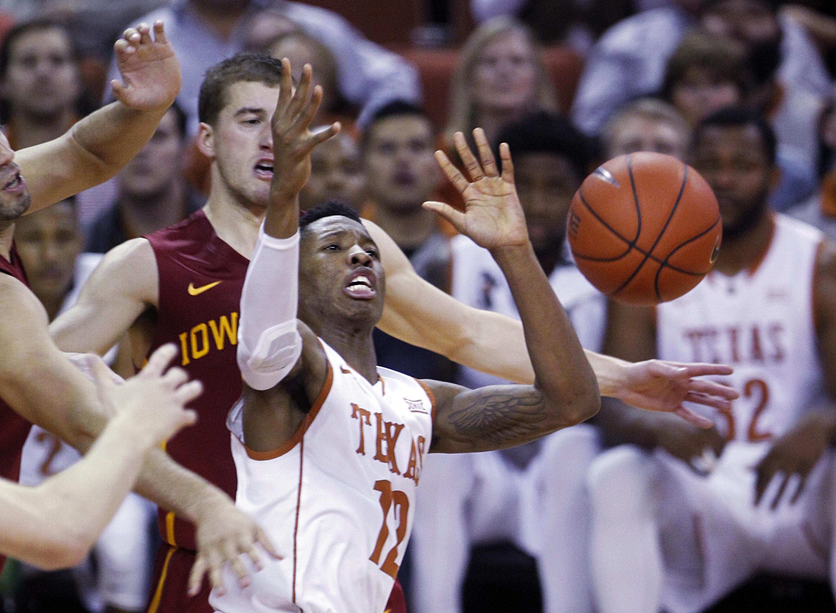 Texas guard Kerwin Roach, Jr. looks to control the loose ball during the second half of an NCAA college basketball game against Iowa State, Tuesday, Jan. 12, 2016, in Austin, Texas. Texas won 94-91. (AP Photo/Michael Thomas)