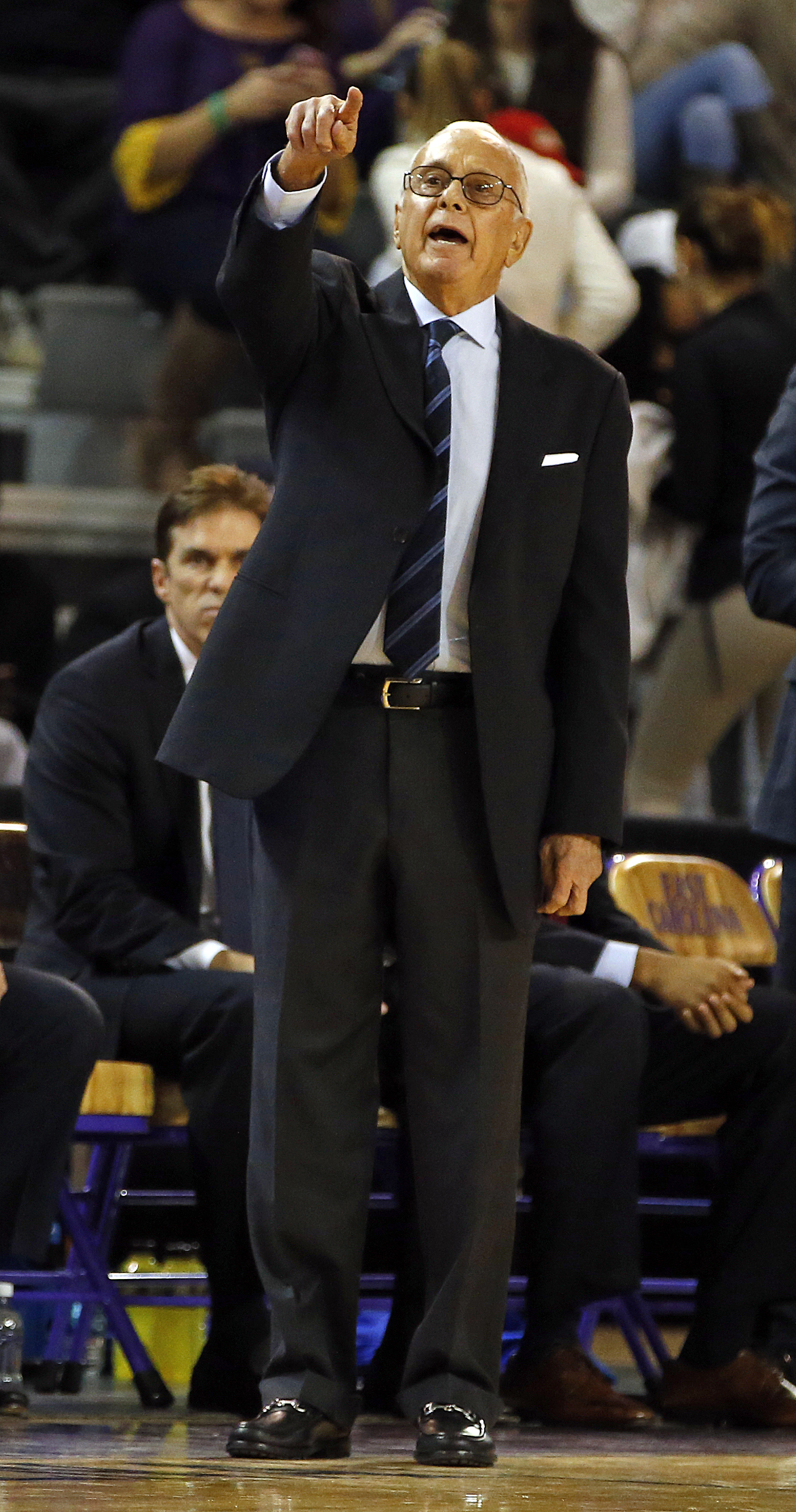 Southern Methodist head coach Larry Brown yells instructions to his team during the first half of an NCAA college basketball game against the East Carolina in Greenville, N.C., Wednesday, Jan. 13, 2016. (AP Photo/Karl B DeBlaker)