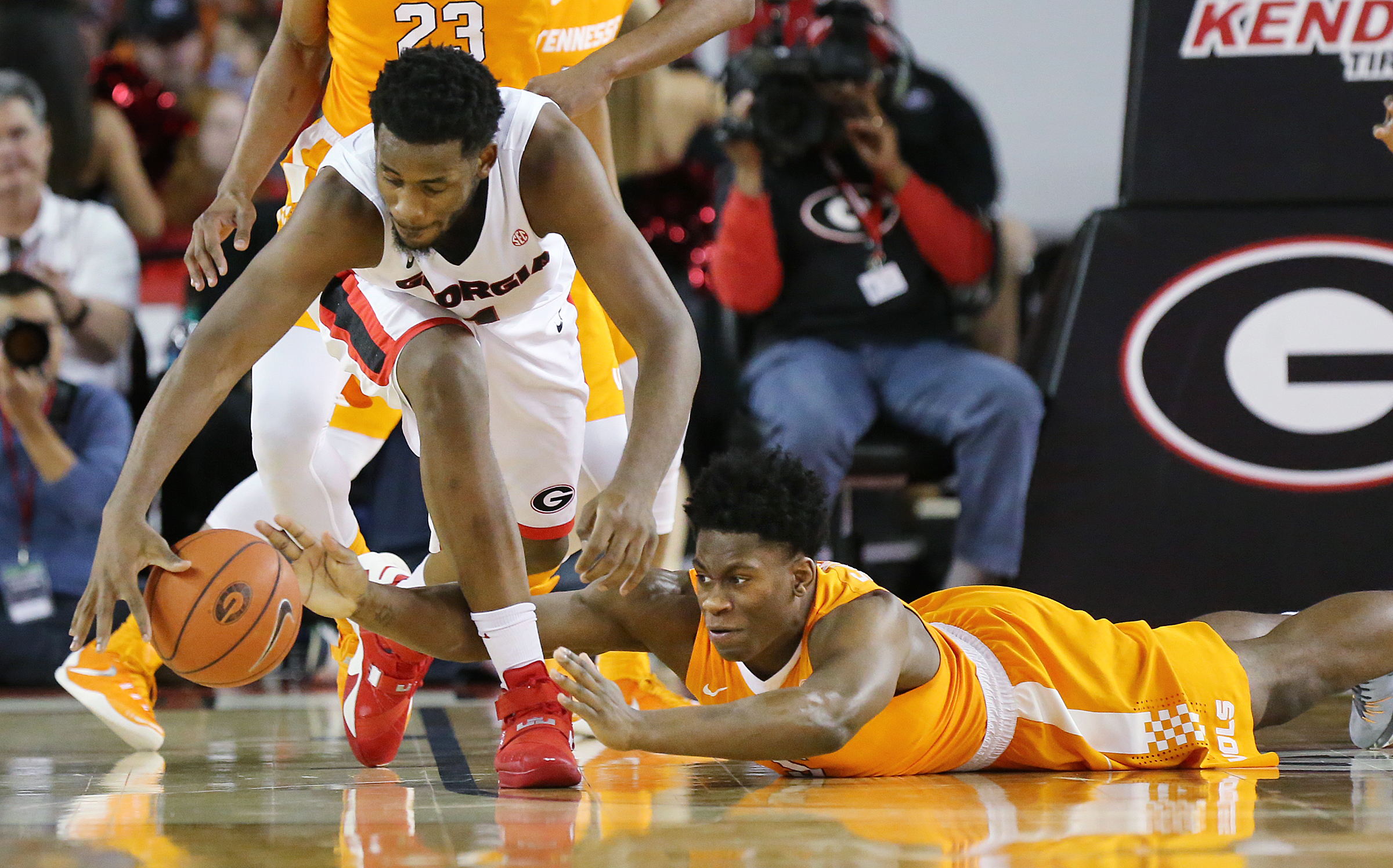 Georgia guard William Jackson II and Tennessee forward Admiral Schofield reach for the ball during the first half of an NCAA college basketball game Wednesday, Jan. 13, 2016, in Athens, Ga. (Curtis Compton/Atlanta Journal Constitution via AP)