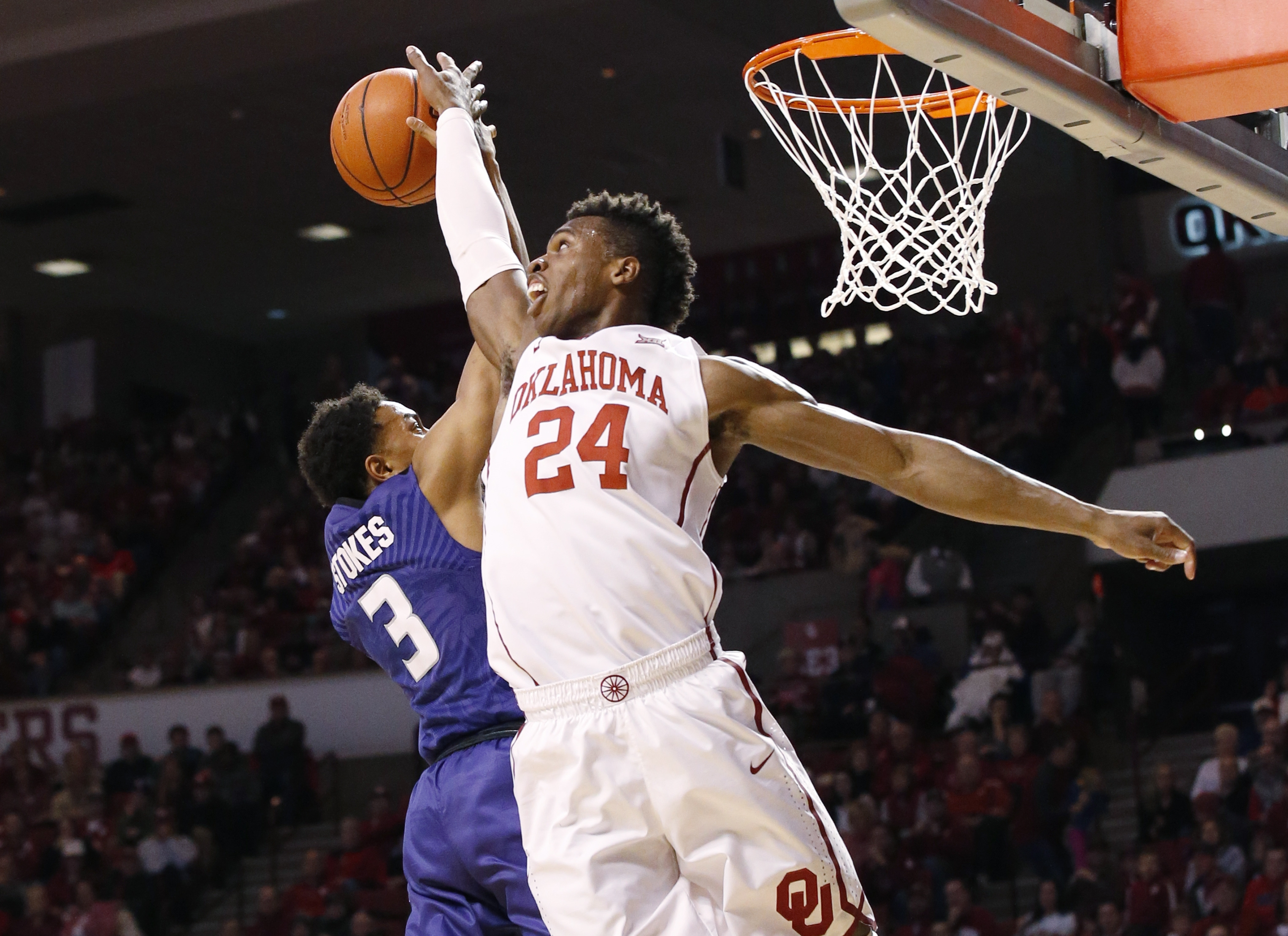 FILE - In this Jan. 9, 2016, file photo, Oklahoma guard Buddy Hield (24) blocks a shot by Kansas State guard Kamau Stokes (3) in the first half of an NCAA college basketball game in Norman, Okla. The college basketball season is already 2 months old and l