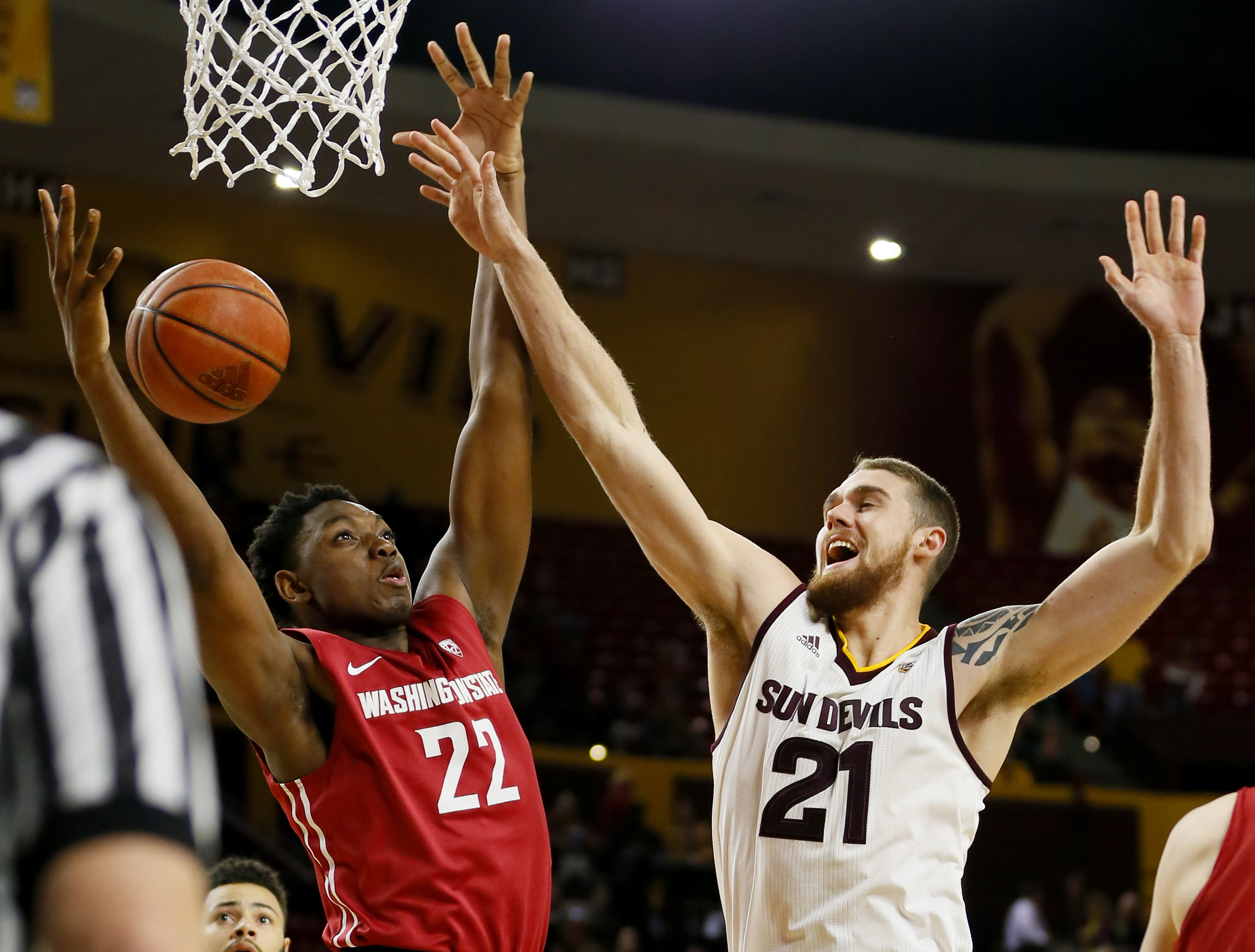 Arizona State forward Eric Jacobsen, right, and Washington State forward Robert Franks reach for a rebound during the second half of an NCAA college basketball game, Thursday, Jan. 14, 2016, in Tempe, Ariz. (AP Photo/Matt York)