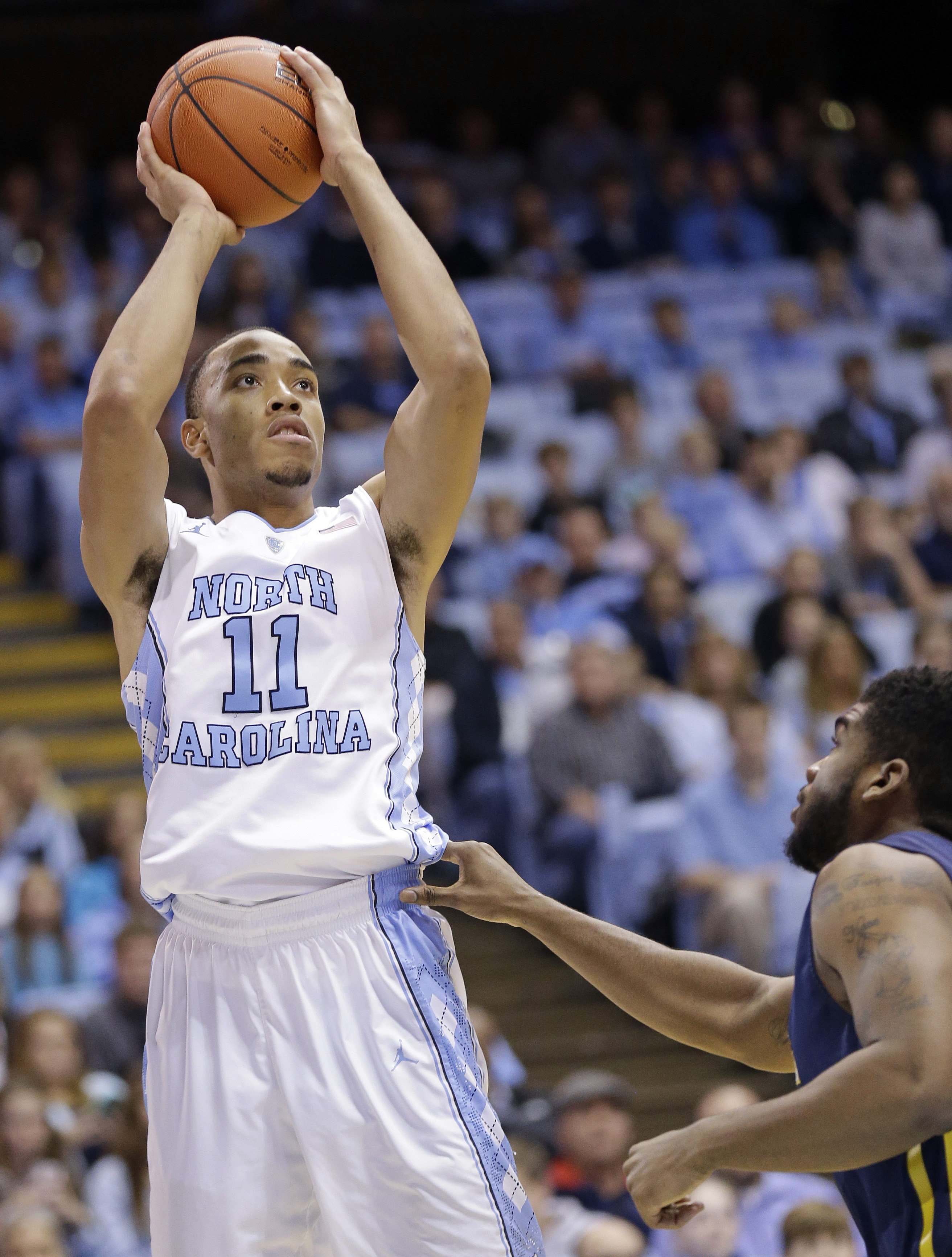 FILE - In this Dec. 28, 2015, file photo, North Carolina's Brice Johnson (11) shoots over UNC Greensboro's Kayel Locke during an NCAA college basketball game in Chapel Hill, N.C. Johnson is averaging a team-best 16.7 points on 64-percent shooting entering