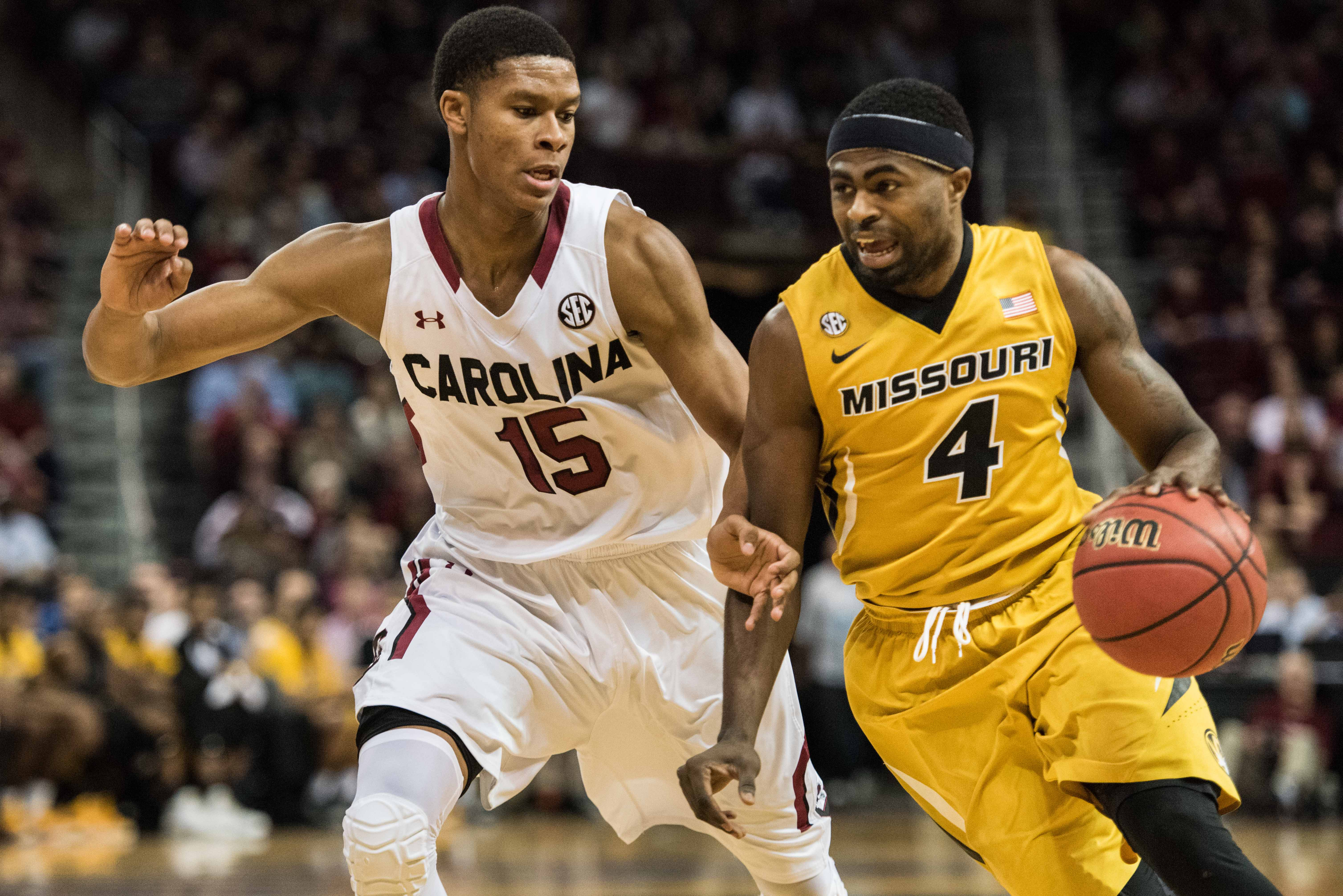 Missouri guard Tramaine Isabelle (4) drives to the hoop against South Carolina guard PJ Dozier (15) during the first half of an NCAA college basketball game Saturday, Jan. 16, 2016, in Columbia, S.C. (AP Photo/Sean Rayford)