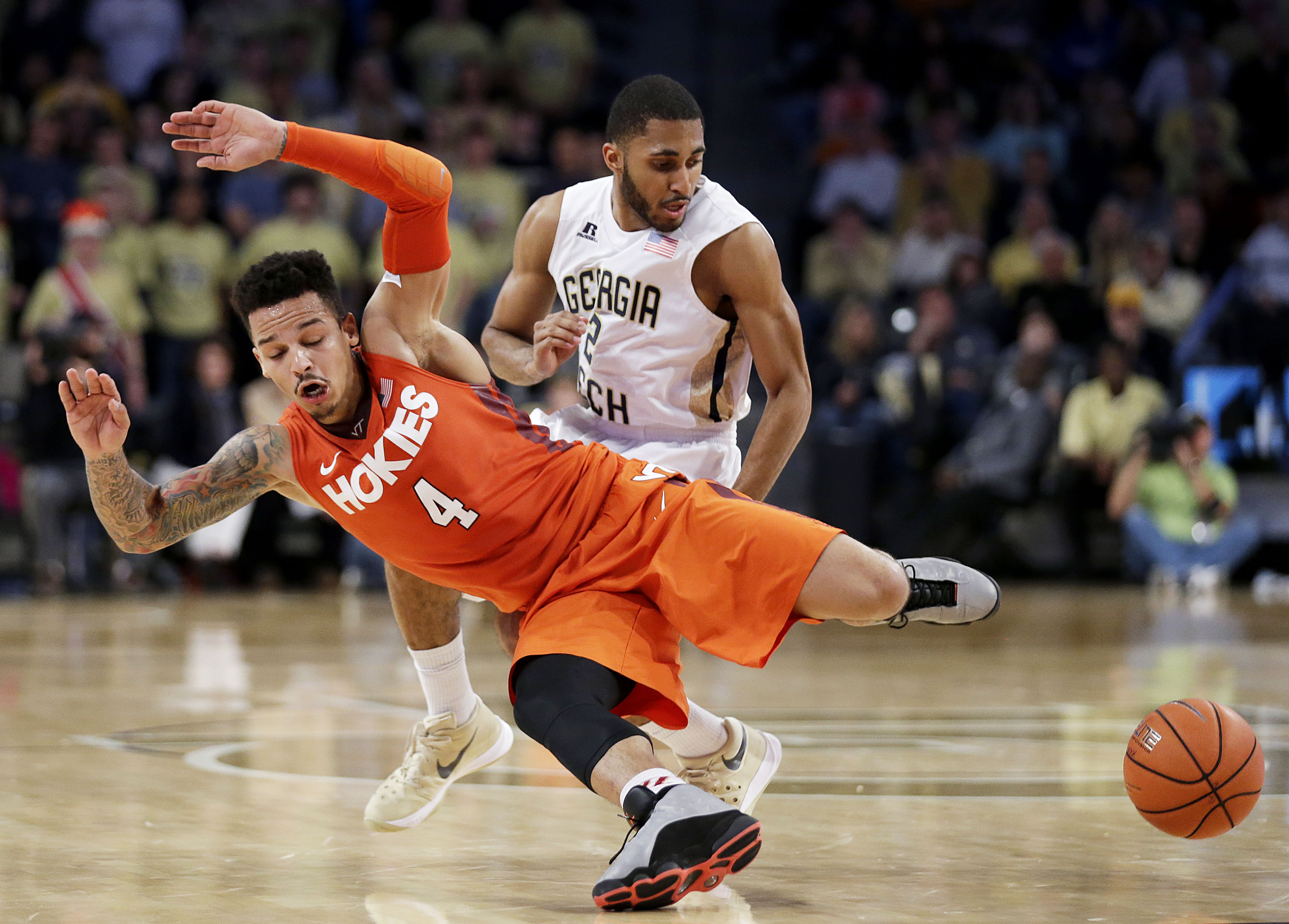 Virginia Tech's Seth Allen, foreground, collides with Georgia Tech's Adam Smith over a loose ball in the second half of an NCAA college basketball game Saturday, Jan. 16, 2016, in Atlanta. Virginia Tech won 78-77. (AP Photo/David Goldman)