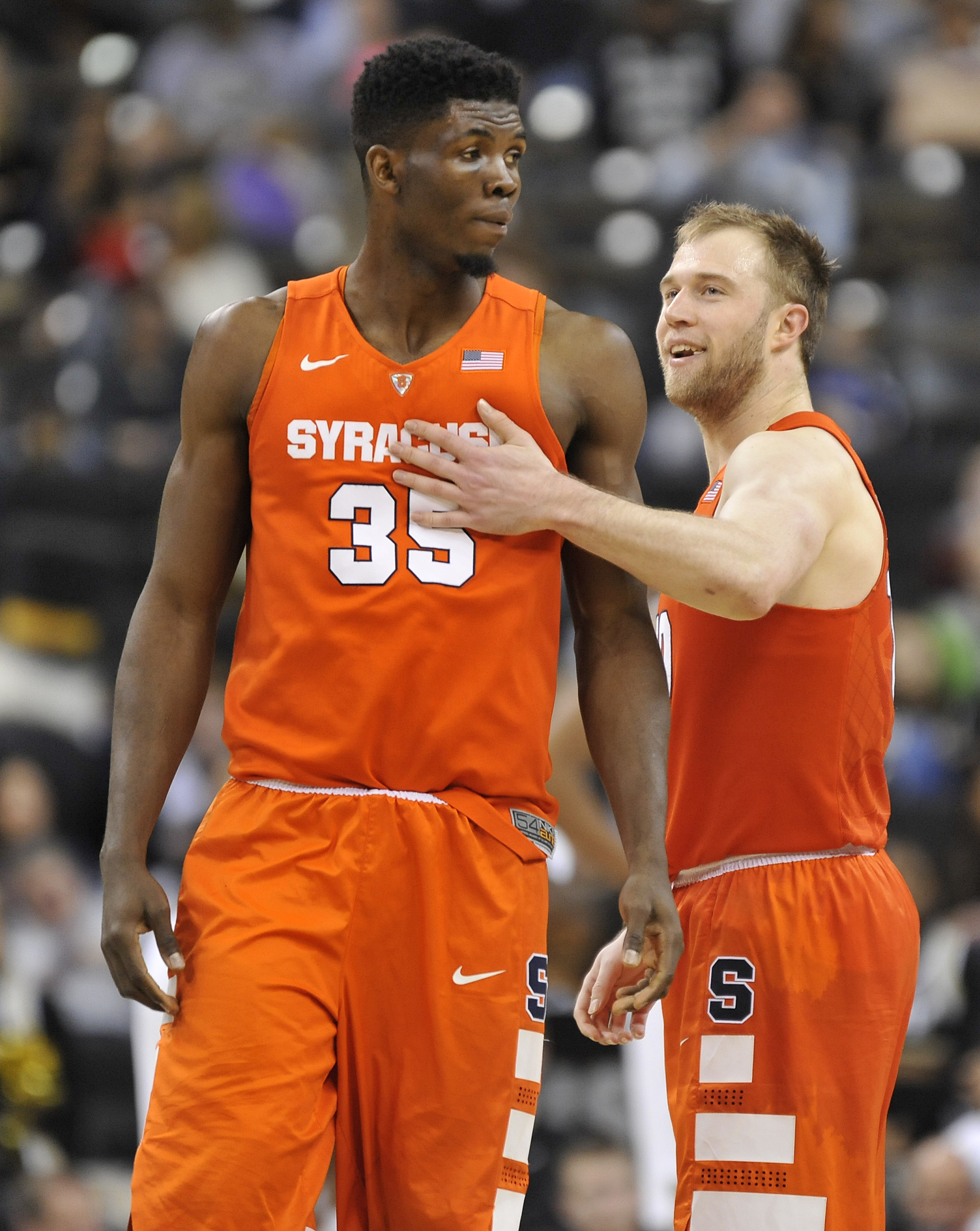 Syracuse guard Trevor Cooney (10) congratulates center Chinonso Obokoh (35) during an NCAA college basketball game at Joel Coliseum in Winston-Salem, N.C., Saturday Jan. 16, 2016.  (Bruce Chapman/The Winston-Salem Journal via AP) MANDATORY CREDIT  MBI(