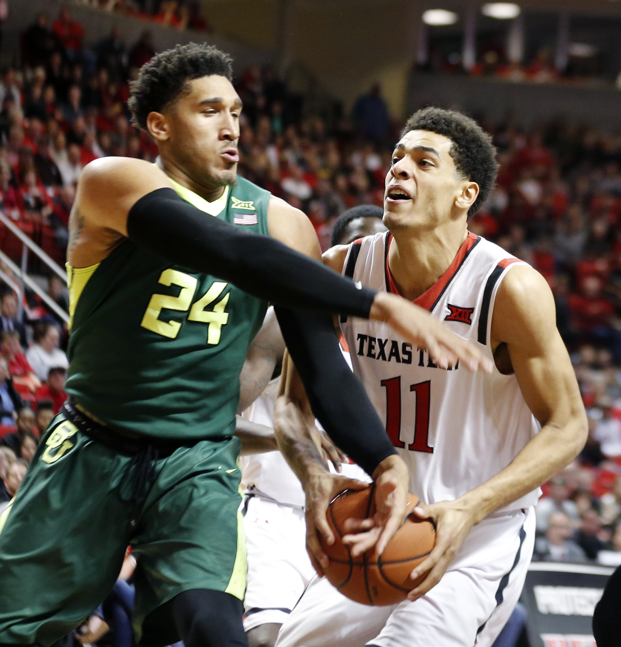 Baylor guard Ishmail Wainright and Texas Tech forward Zach Smith tangle in the first period during an NCAA college basketball game against Baylor University, Saturday, Jan. 16, 2016, in Lubbock, Texas. (Mark Rogers/Lubbock Avalanche-Journal via AP) MANDAT