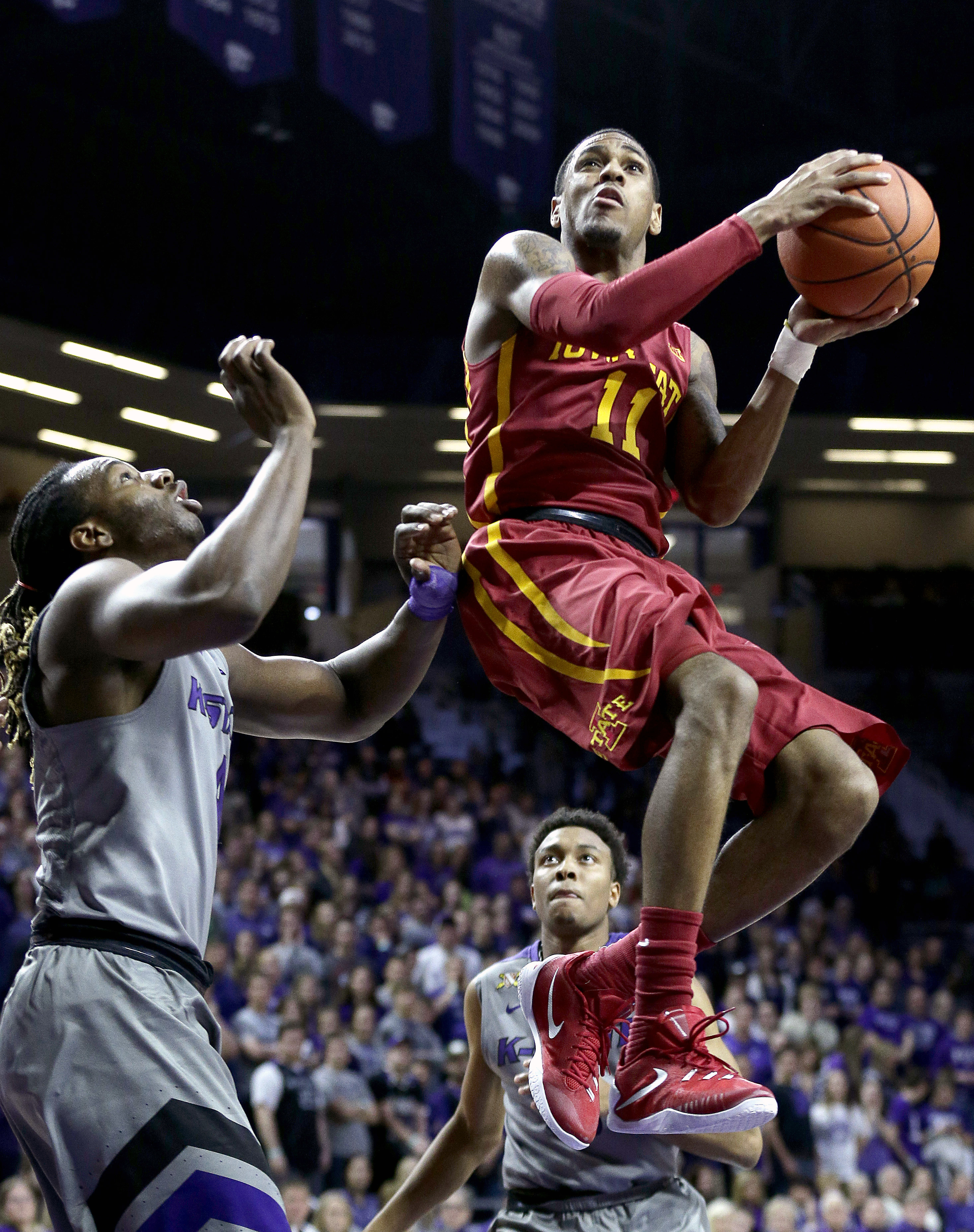 Iowa State's Monte Morris (11) gets by Kansas State's D.J. Johnson, left, to shoot during the first half of an NCAA college basketball game Saturday, Jan. 16, 2016, in Manhattan, Kan. (AP Photo/Charlie Riedel)