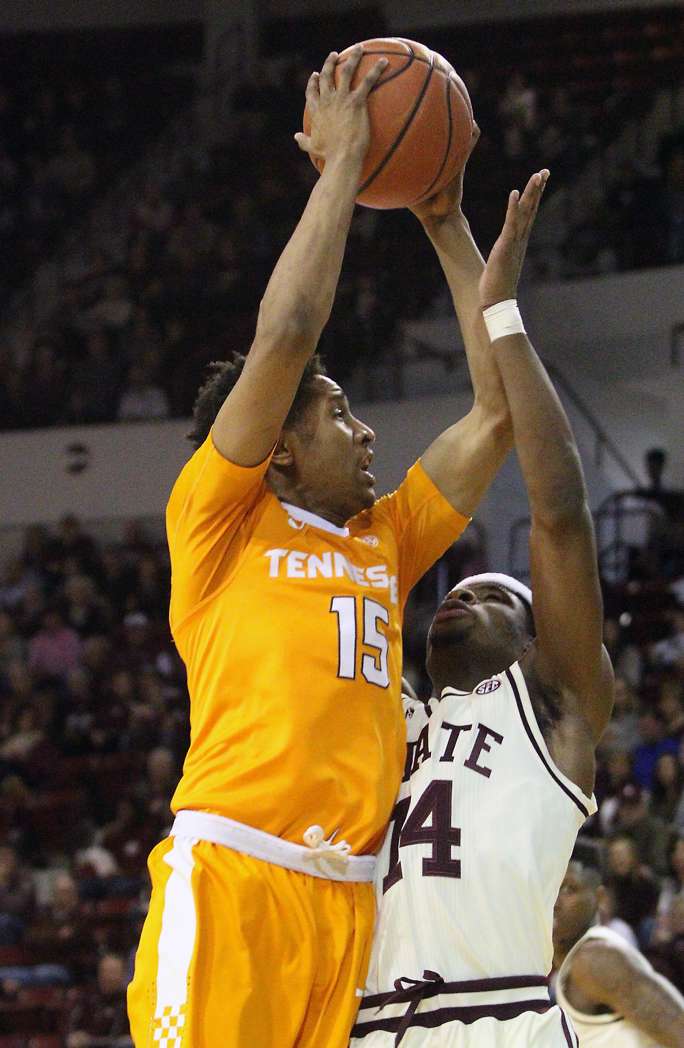 Tennessee guard Detrick Mostella (15) shoots over Mississippi State guard Malik Newman (14) during the first half of an NCAA college basketball game in Starkville, Miss., Saturday, Jan. 16, 2016. Tennessee won 80-75. (AP Photo/Jim Lytle)