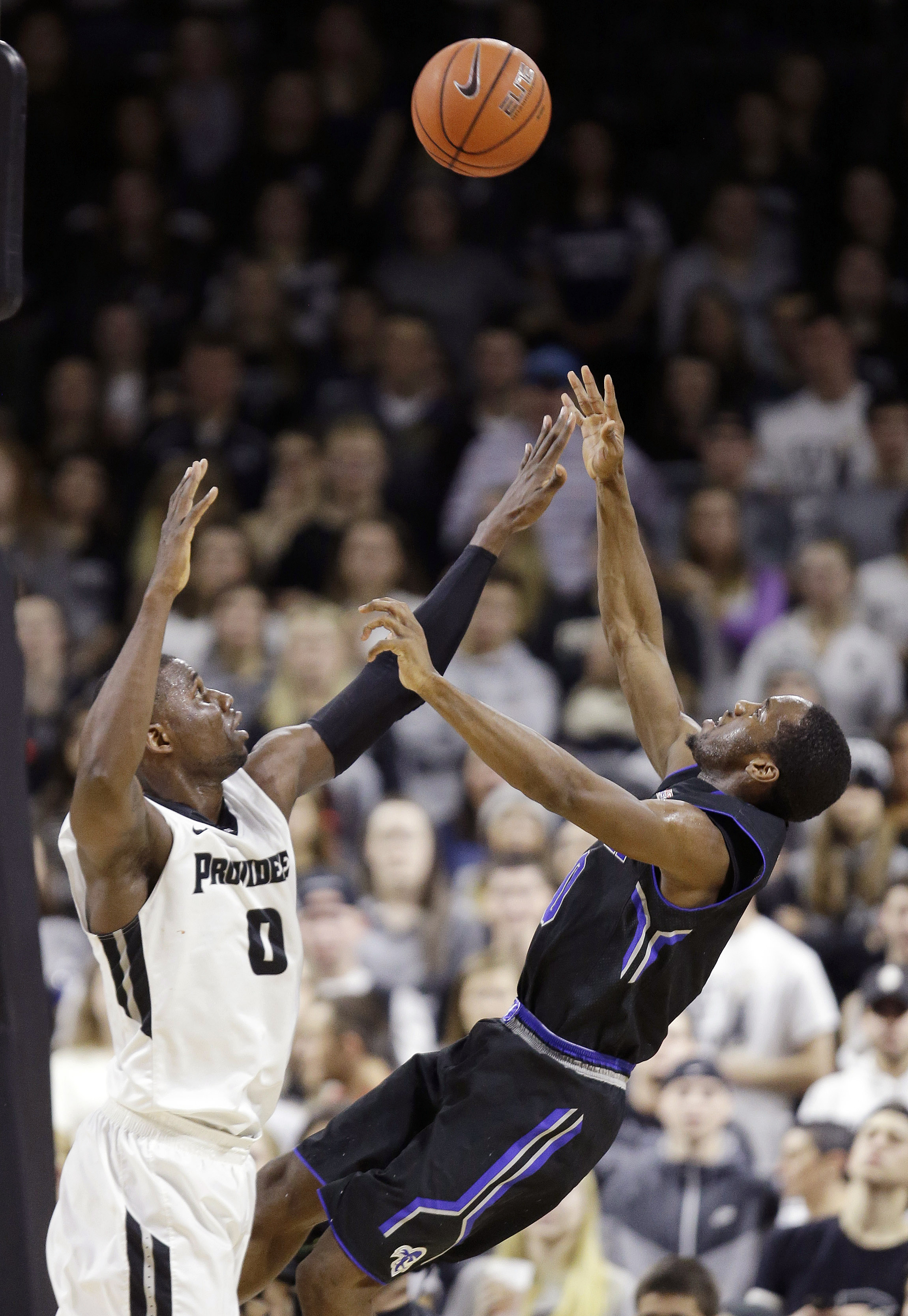 Seton Hall guard Khadeen Carrington (0) shoots over Providence forward Ben Bentil (0) during the first half of an NCAA college basketball game Saturday, Jan. 16, 2016, in Providence, R.I. Seton Hall defeated Providence 81-72. (AP Photo/Stephan Savoia)
