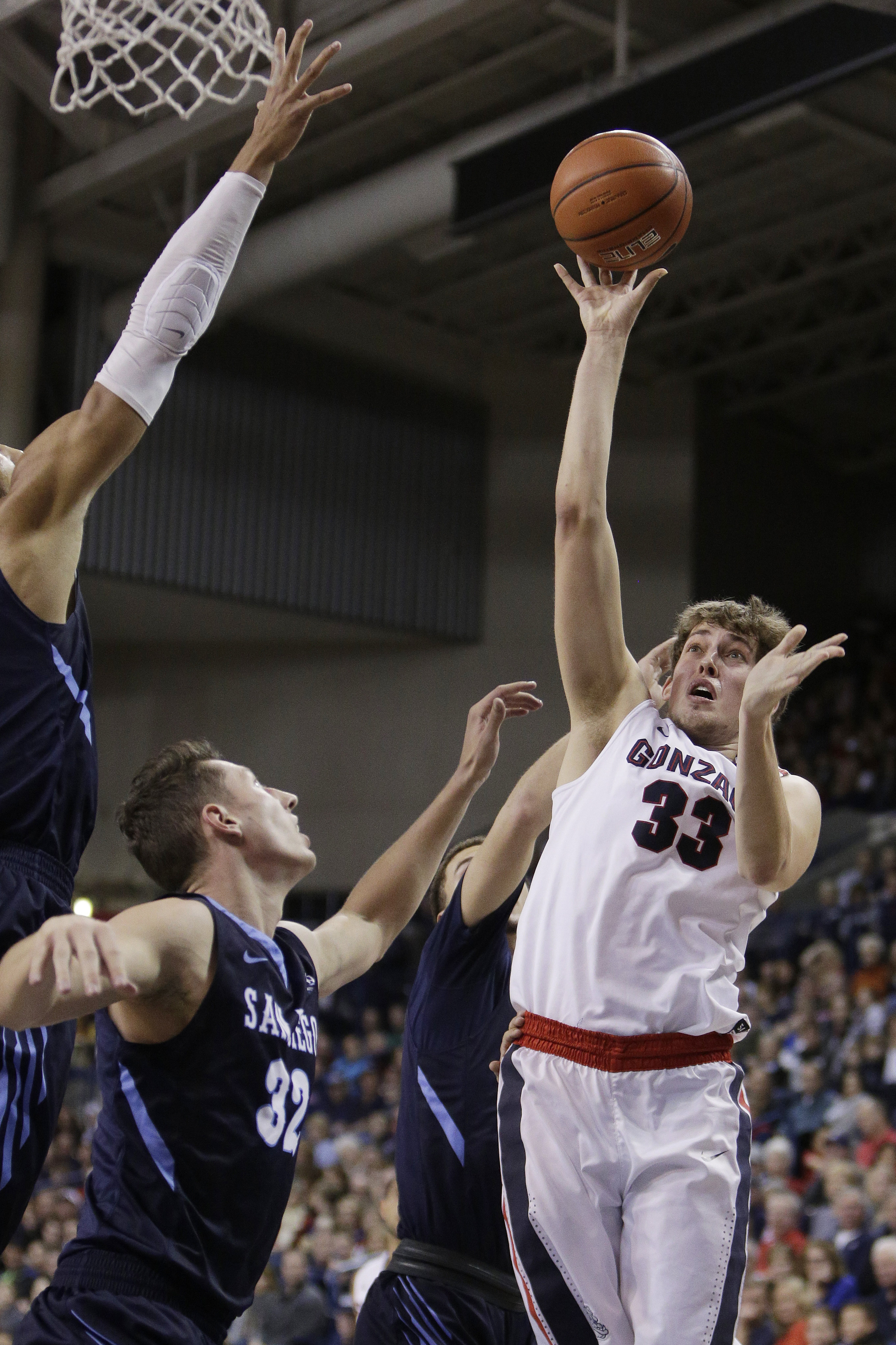 Gonzaga's Kyle Wiltjer (33) shoots against San Diego's Brett Bailey (32), Jito Kok, left, and Tyler Williams during the first half of an NCAA college basketball game, Saturday, Jan. 16, 2016, in Spokane, Wash. (AP Photo/Young Kwak)