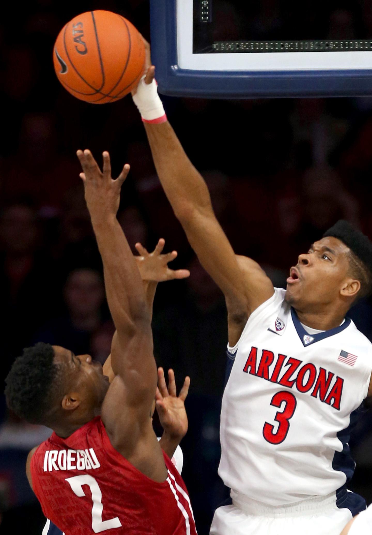 Arizona guard Justin Simon (3) blocks a shot by Washington State guard Ike Iroegbu (2) during an NCAA college basketball game Saturday, Jan. 16, 2016, Tucson, Ariz. (Kelly Presnell/Arizona Daily Star via AP)  ALL LOCAL TELEVISION OUT; PAC-12 OUT; MANDATOR