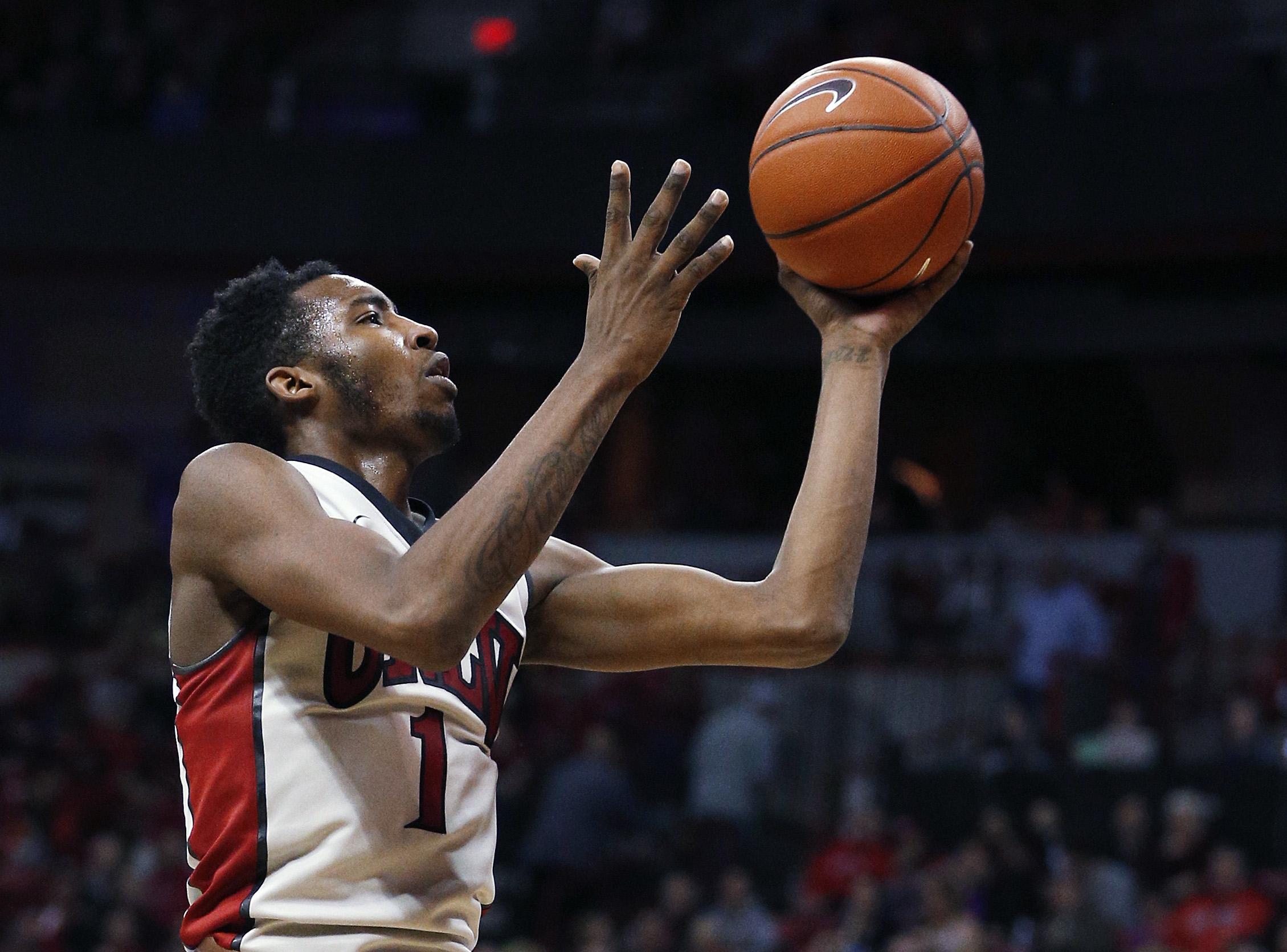 UNLV forward Derrick Jones Jr. shoots against Air Force during the second half of an NCAA college basketball game Saturday, Jan. 16, 2016, in Las Vegas. UNLV won 100-64. (AP Photo/John Locher)