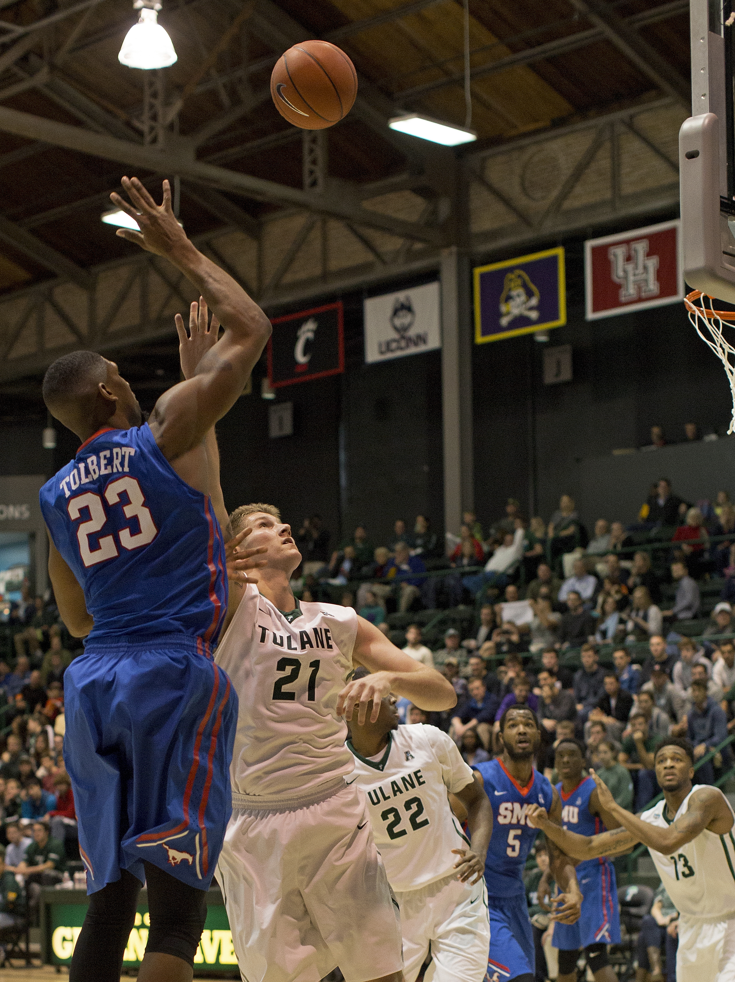 SMU forward Jordan Tolbert (23) makes a shot over Tulane forward Dylan Osetkowski (21) in the first half of an NCAA college basketball game in New Orleans, Sunday, Jan. 17, 2016. (AP Photo/Max Becherer)