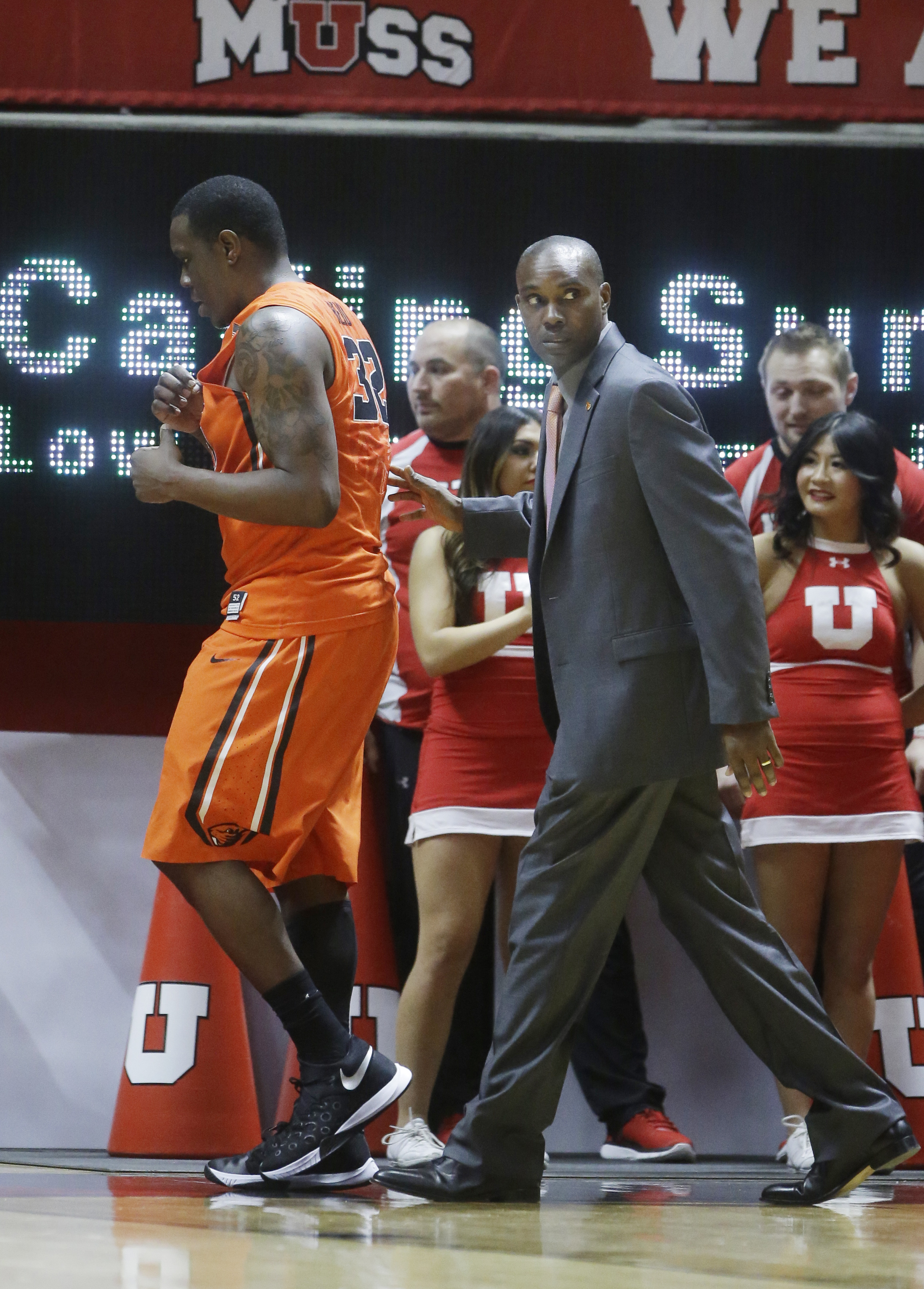 Oregon State forward Jarmal Reid (32) walks off the court after being ejected for tripping a referee during the second half of an NCAA college basketball game Sunday, Jan. 17, 2016, in Salt Lake City. Utah won 59-53. (AP Photo/Rick Bowmer)