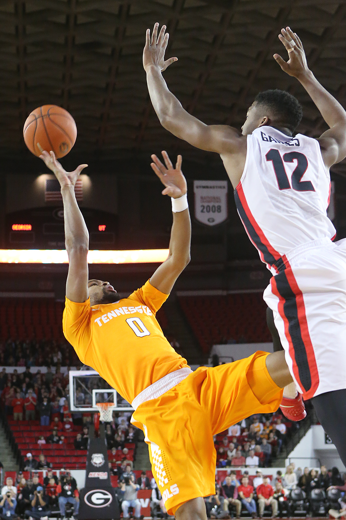 FILE - In this Jan. 13, 2016, file photo, Georgia guard Kenny Gaines blocks a shot by Tennessee guard Kevin Punter during an NCAA college basketball game, in Athens, Ga. Tennessee's lack of size has the Volunteers relying on an unusual lineup lately. The