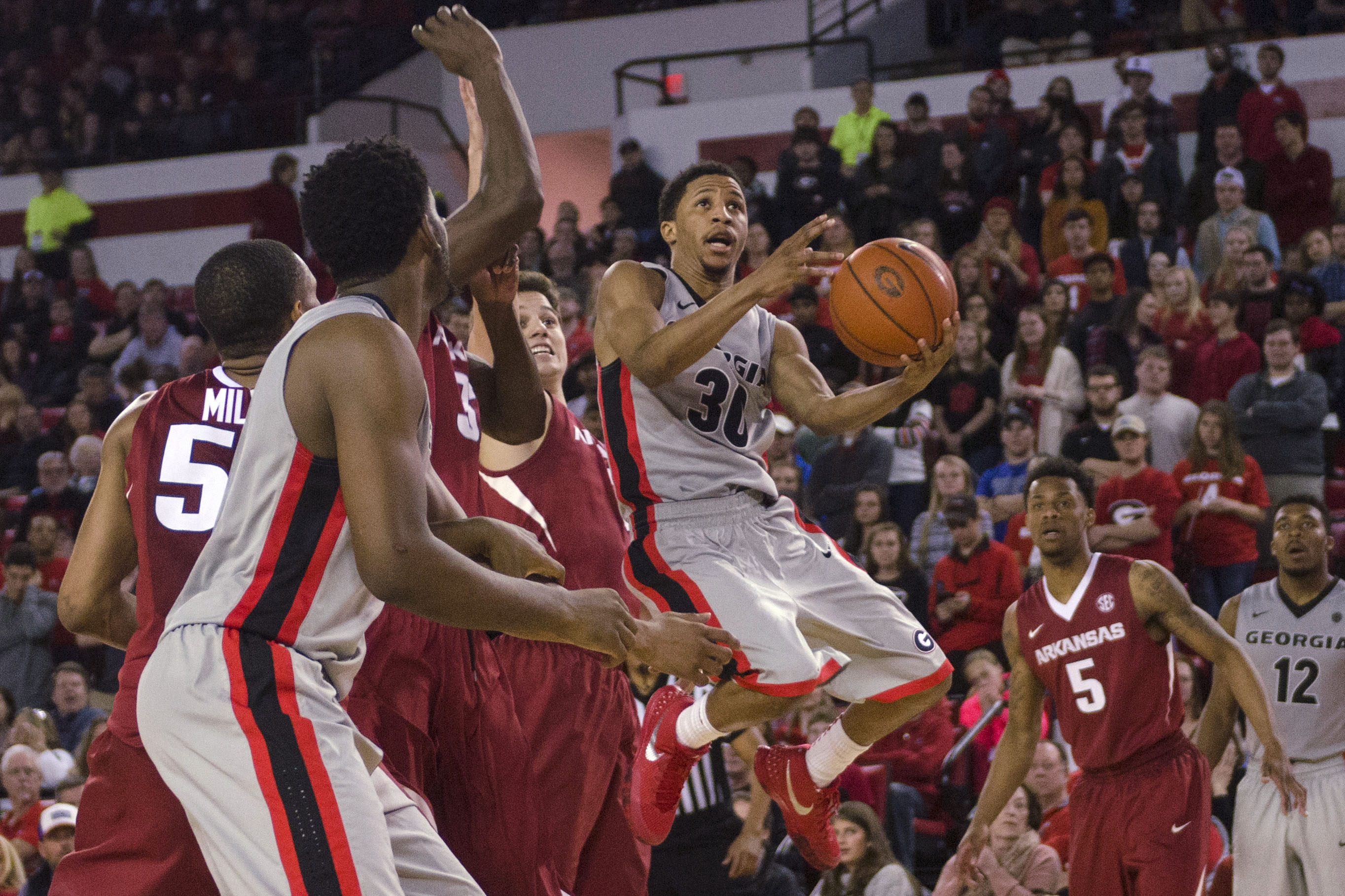Georgia guard J.J. Frazier (30) drives to the basket during an NCAA college basketball game against Arkansas on Saturday, Jan. 23, 2016, in Athens, Ga. (Taylor Craig Sutton/Athens Banner-Herald via AP)