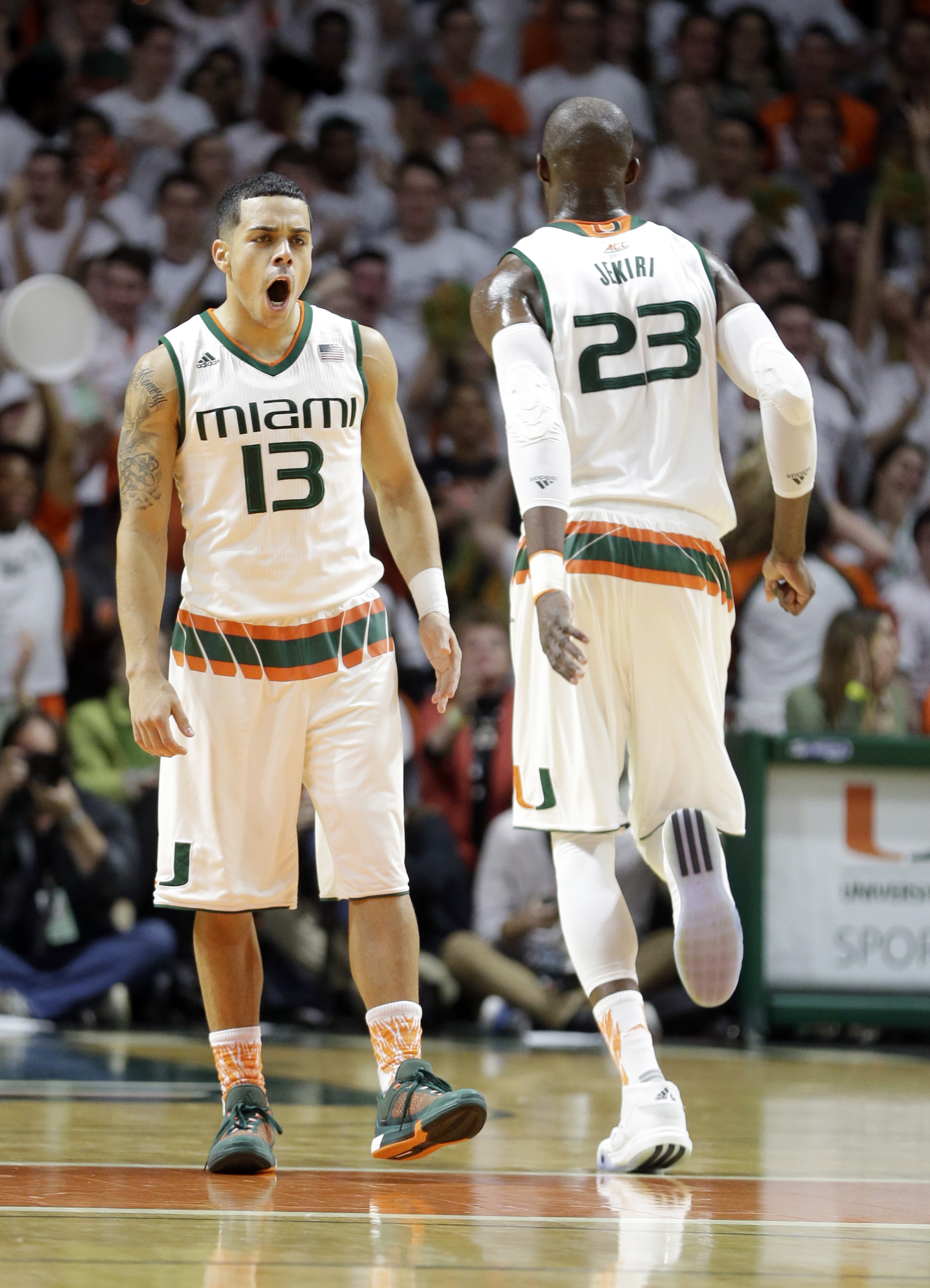 Miami guard Angel Rodriguez (13) celebrates after scoring a three-pointer against Duke  during the first half of an NCAA college basketball game, Monday, Jan. 25, 2016, in Coral Gables, Fla. (AP Photo/Alan Diaz)