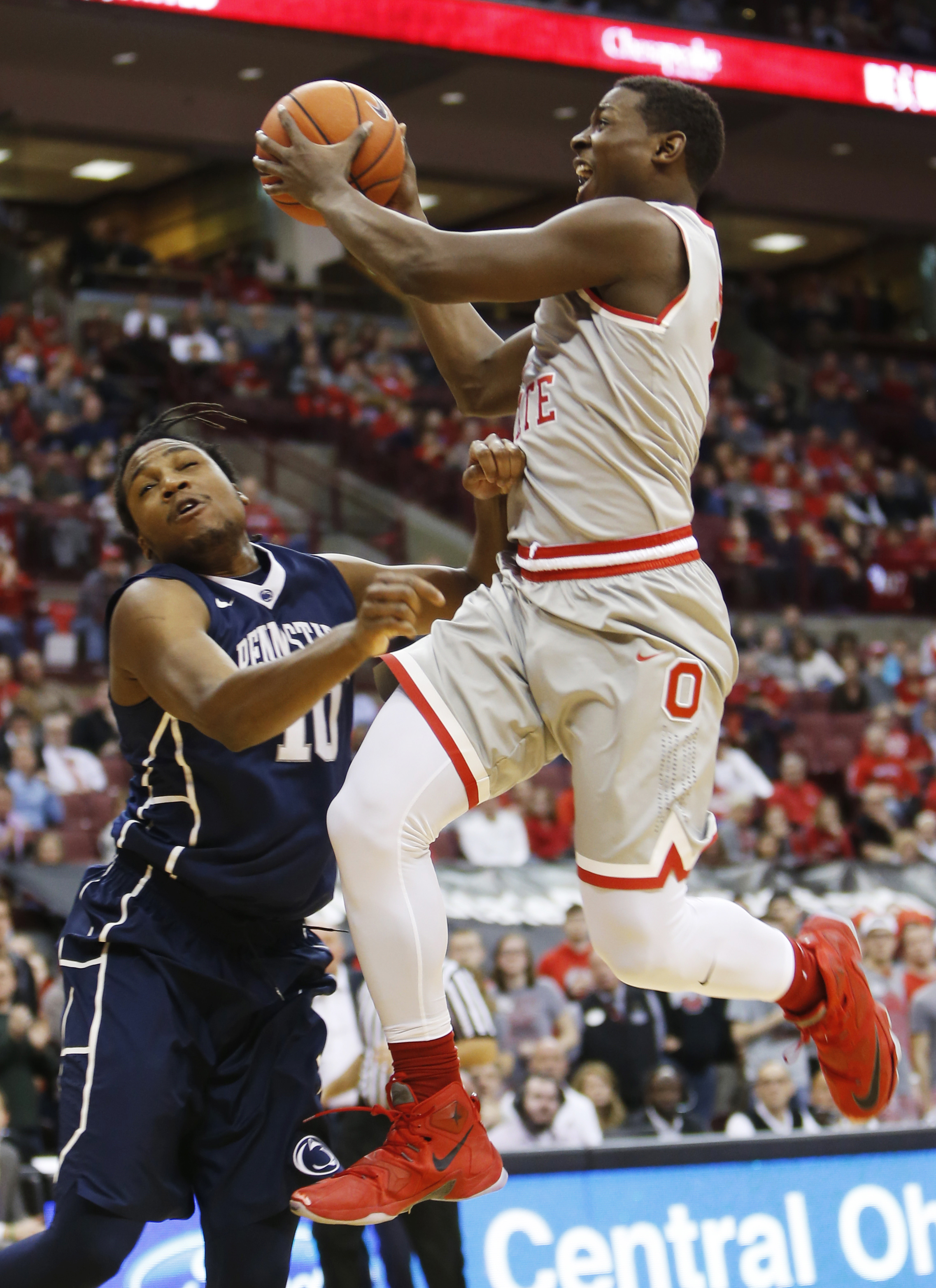 Ohio State's Jai'Sean Tate, right, shoots the ball as Penn State's Brandon Taylor defends during the second half of an NCAA college basketball game Monday, Jan. 25, 2016, in Columbus, Ohio. Ohio State beat Penn State 66-46. (AP Photo/Jay LaPrete)