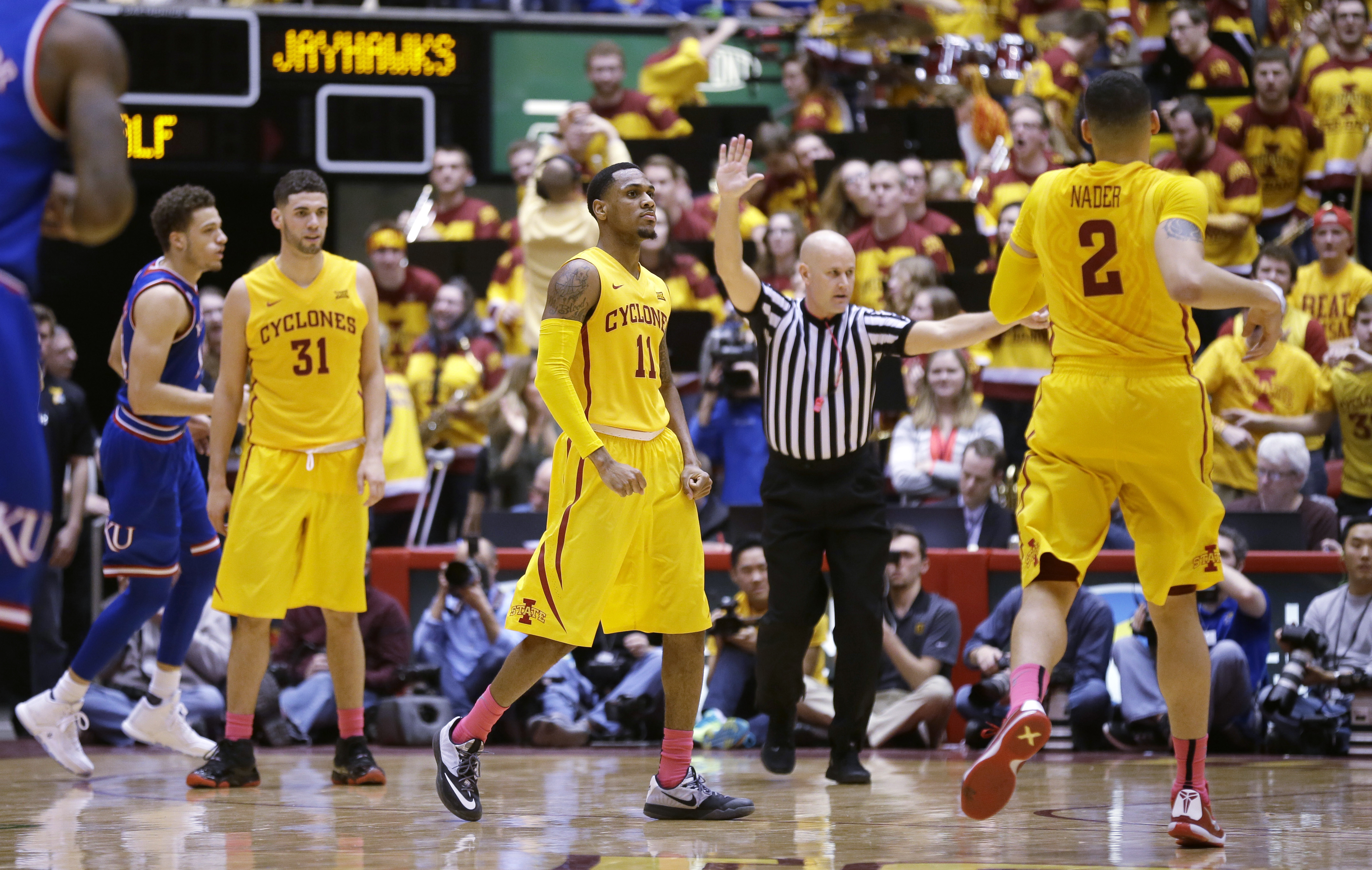 Iowa State guard Monte Morris (11) celebrates with teammates after making a basket during the second half of an NCAA college basketball game against Kansas, Monday, Jan. 25, 2016, in Ames, Iowa. (AP Photo/Charlie Neibergall)