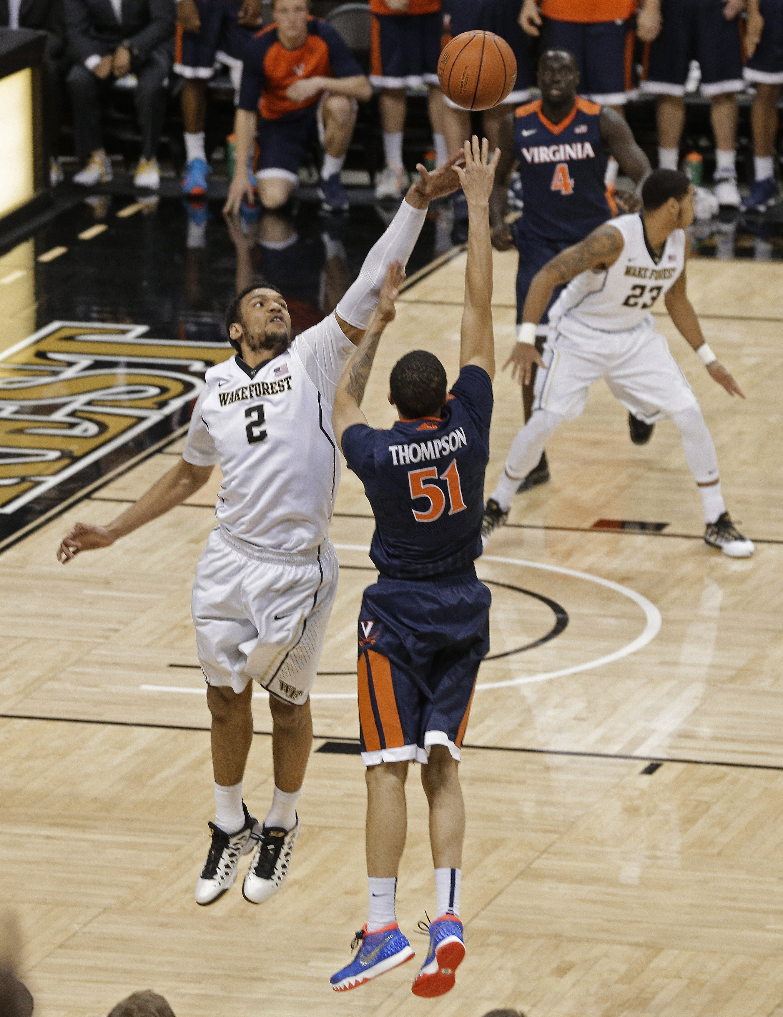 Virginia's Darius Thompson (51) shoots his game-winning basket over Wake Forest's Devin Thomas (2) in the second half of an NCAA college basketball game in Winston-Salem, N.C., Tuesday, Jan. 26, 2016. Virginia won 72-71. (AP Photo/Chuck Burton)
