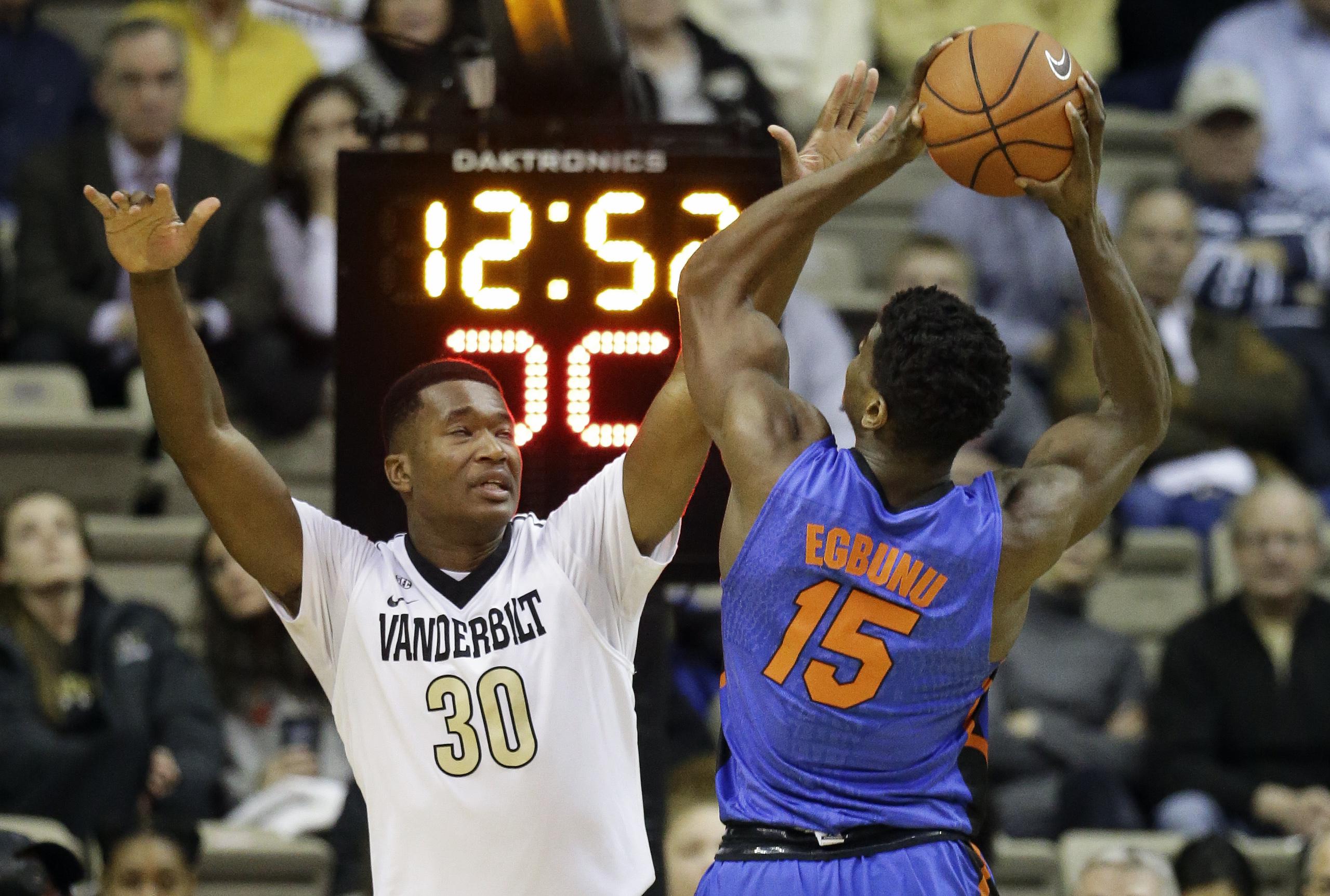 Vanderbilt center Damian Jones (30) defends against Florida center John Egbunu (15) in the first half of an NCAA college basketball game Tuesday, Jan. 26, 2016, in Nashville, Tenn. (AP Photo/Mark Humphrey)