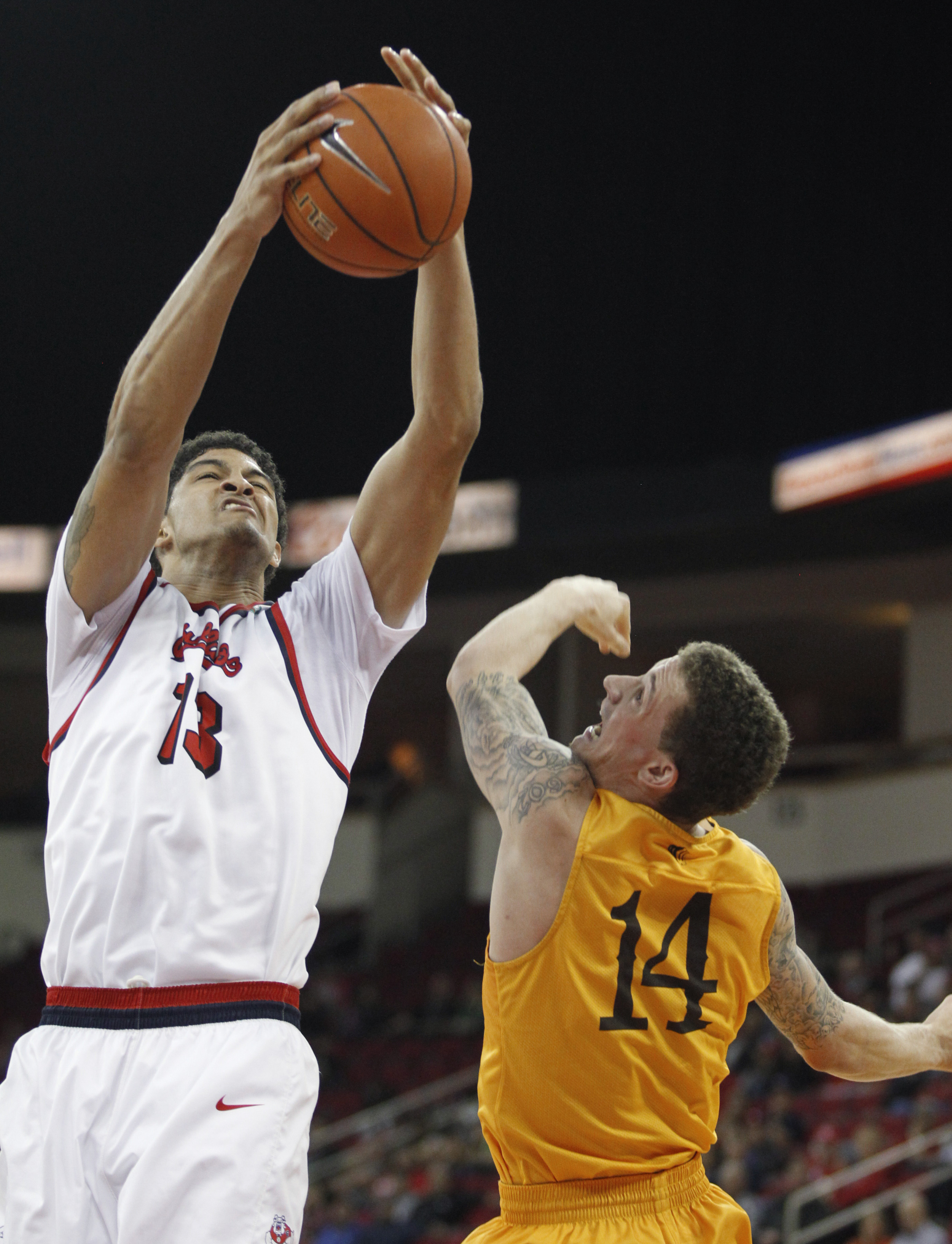 Fresno State's Cullen Russo goes up for a rebound over Wyoming's Josh Adams during the second half of an NCAA college basketball game in Fresno, Calif., Tuesday, Jan. 26, 2016. Fresno State won 71-60. (AP Photo/Gary Kazanjian)