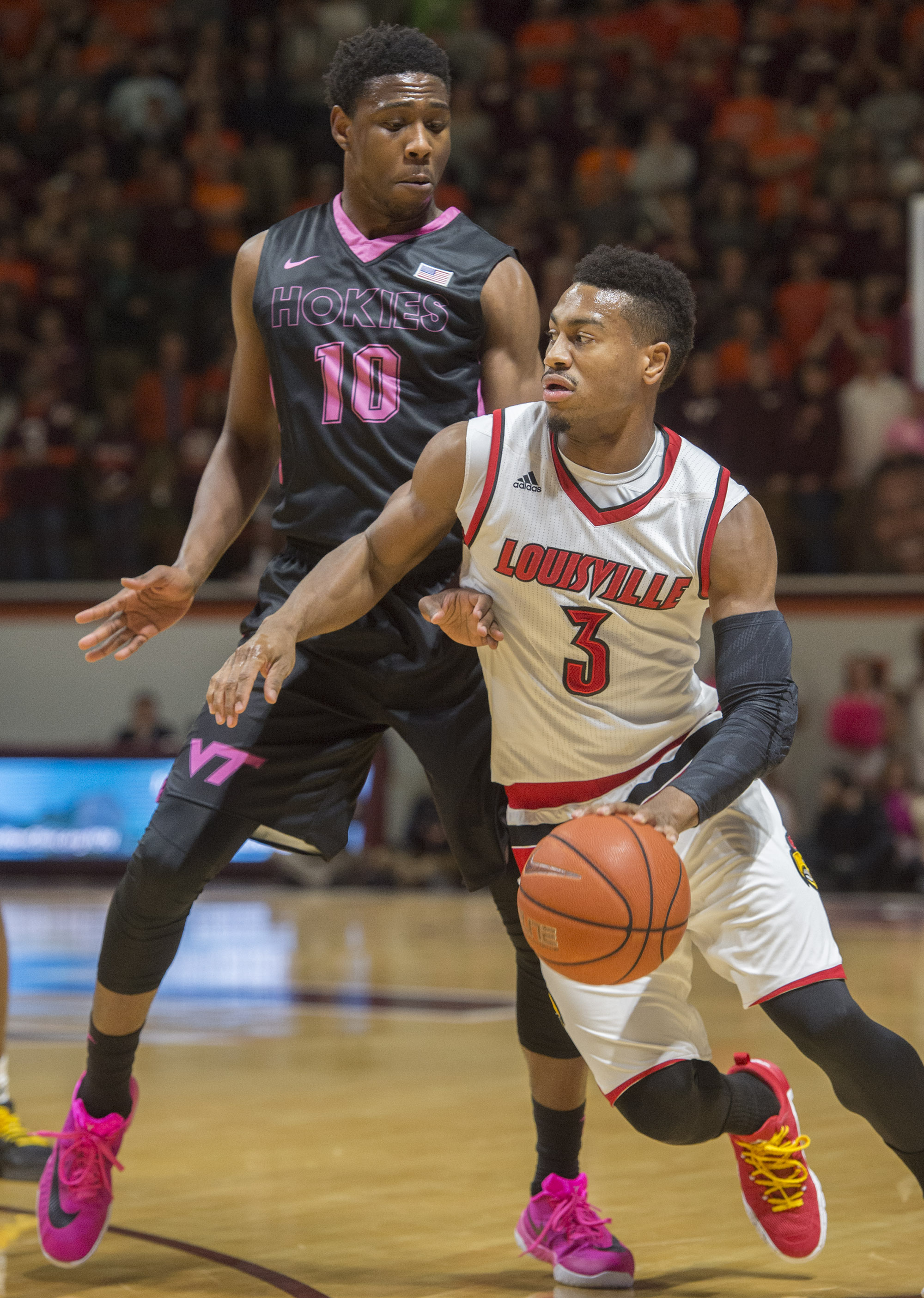 Louisville guard Trey Lewis (3) drives past Virginia Tech guard Justin Bibbs (10) during the first half of an NCAA college basketball game Wednesday, Jan. 27, 2016, in Blacksburg, Va. (AP Photo/Don Petersen)