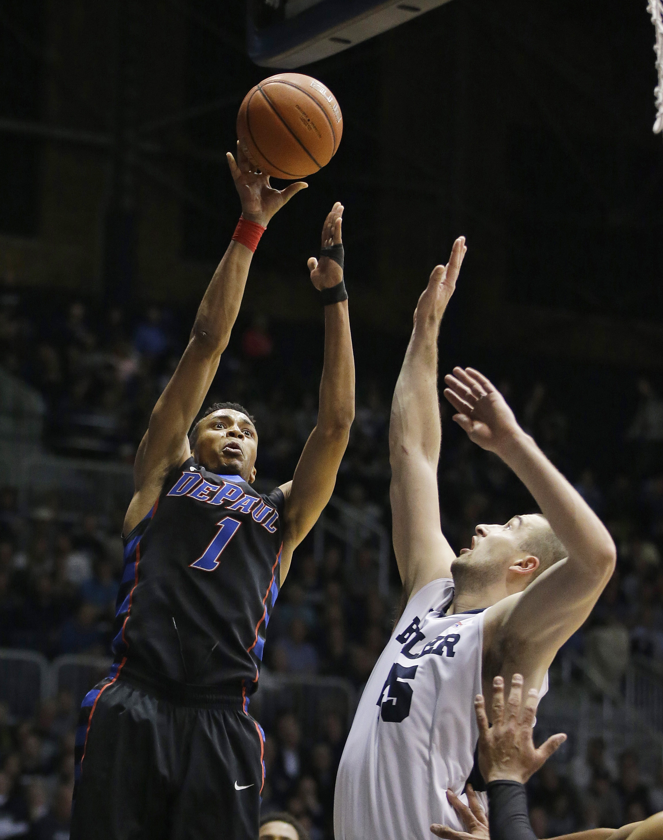 DePaul's Darrick Wood (1) shoots over Butler's Andrew Chrabascz (45) during the second half of an NCAA college basketball game Wednesday, Jan. 27, 2016, in Indianapolis. Butler won 67-53. (AP Photo/Darron Cummings)