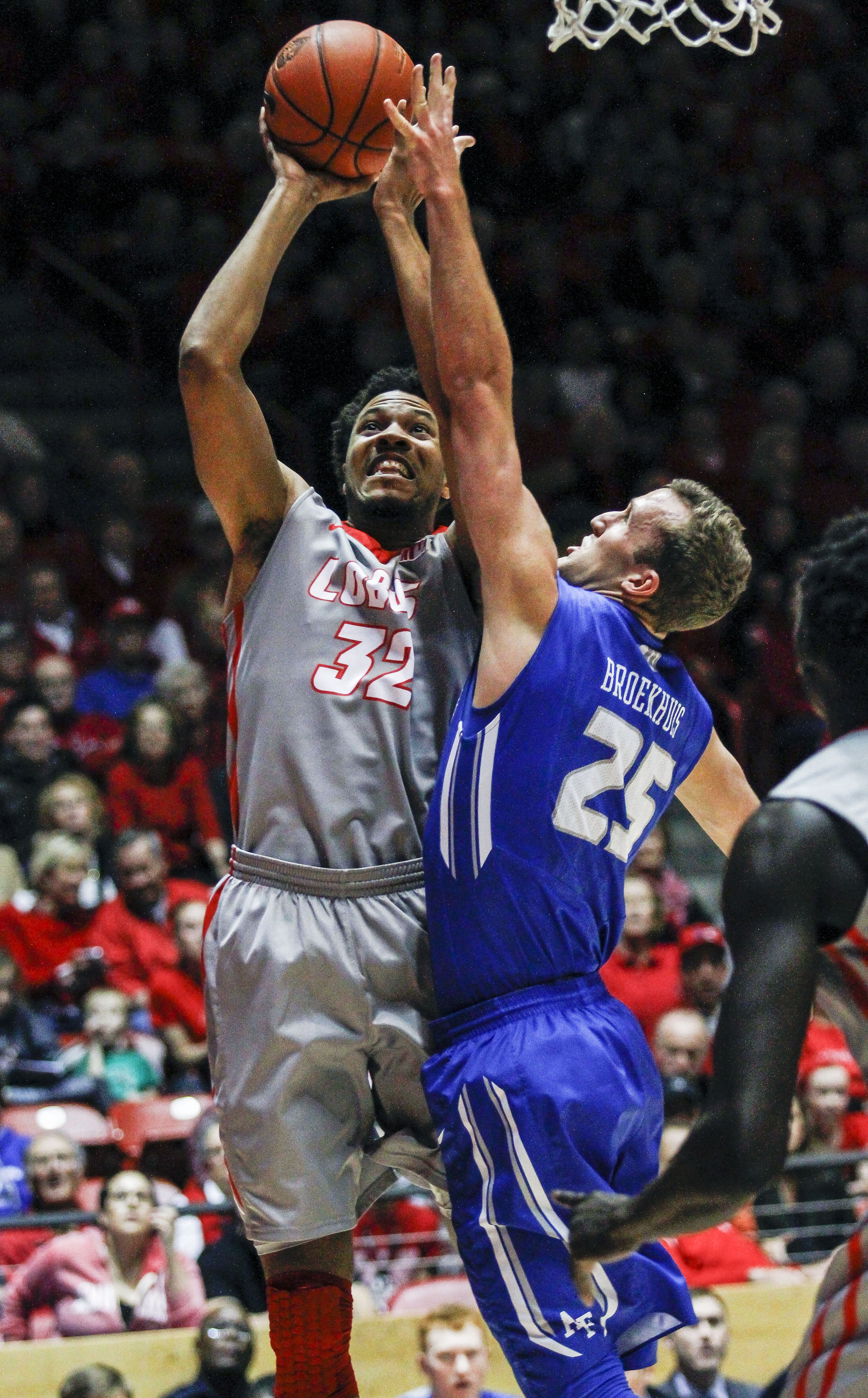 New Mexico's Tim Williams (32) shoots over Air Force's Kyle Broekhuis (25) during the first half an NCAA college basketball game, Wednesday, Jan. 27, 2016, in Albuquerque, N.M. (AP Photo/Juan Labreche)