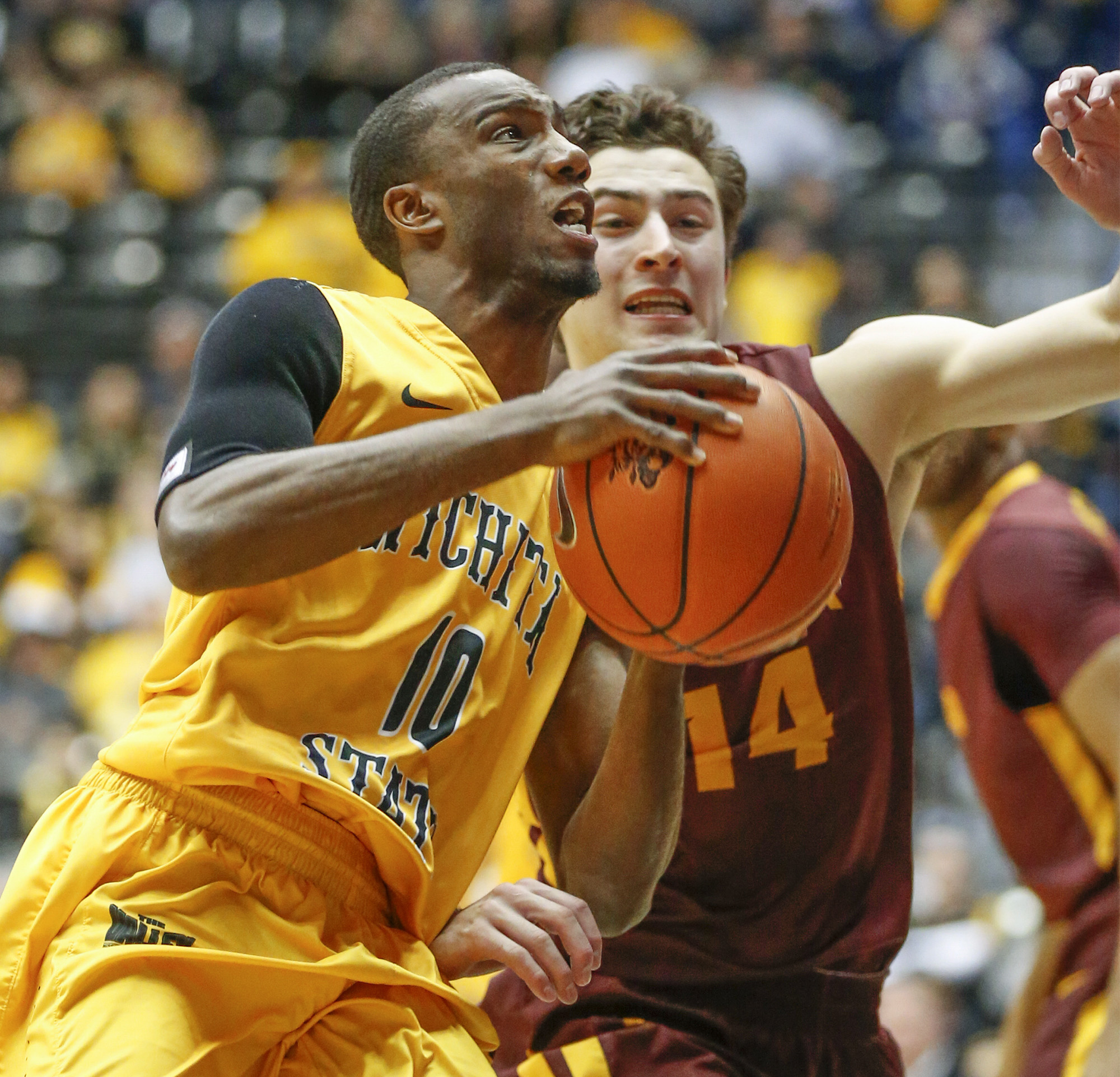 Wichita State's Ty Taylor II (10) drives to the basket against Loyola of Chicago's Ben Richardson during the second half of an NCAA college basketball game Wednesday, Jan. 27, 2016, in Wichita, Kan. (Fernando Salazar/The Wichita Eagle via AP)