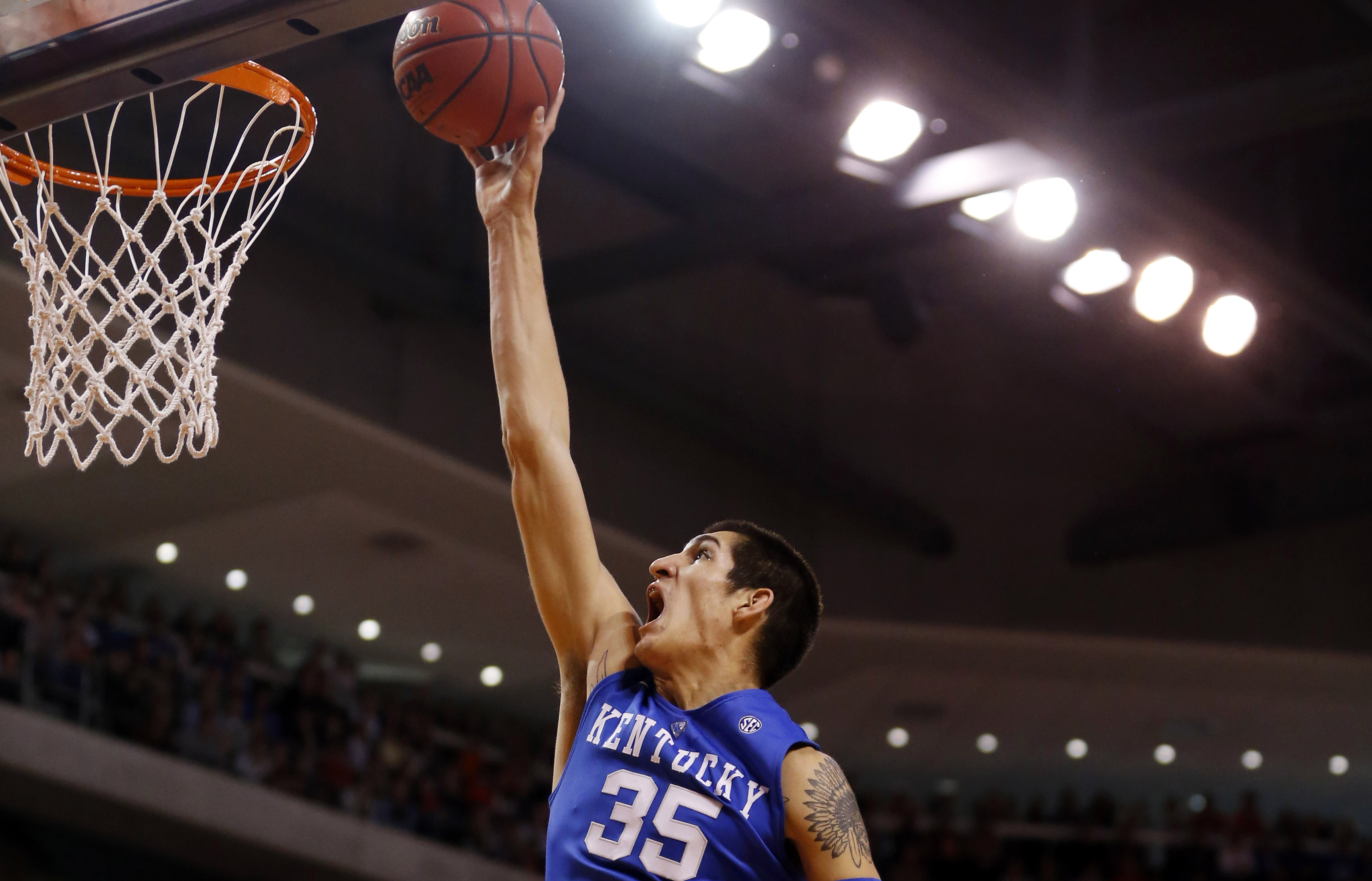 FILE - In this Jan. 16, 2016, file photo, Kentucky forward Derek Willis (35) shoots and scores during the first half of an NCAA college basketball game against Auburn in Auburn, Ala. Kentucky is to play Kansas on Saturday, Jan. 30, in the Big 12/SEC Chall