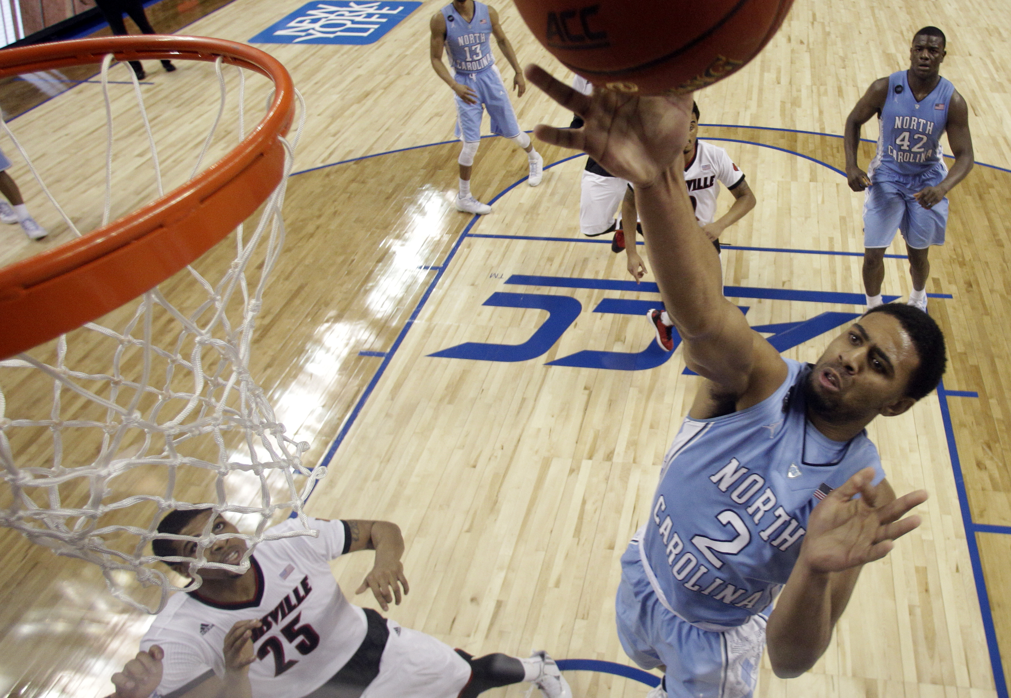 FILE - In this March 12, 2015, file photo, North Carolina's Joel Berry II (2) shoots against Louisville during the first half of an NCAA college basketball game in the quarterfinals of the Atlantic Coast Conference tournament in Greensboro, N.C. Berry sai