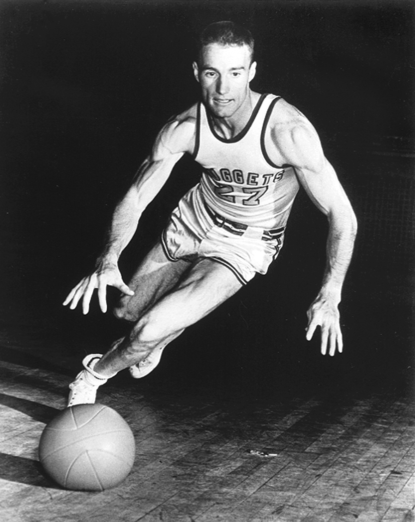 FILE - In this 1950 file photo, the Denver Nuggets' Kenny Sailors dribbles a basketball.  Sailors, a College basketball Hall of Famer and the man credited by some with being the first to use the modern jump shot, died in his sleep early Saturday, Jan. 30,