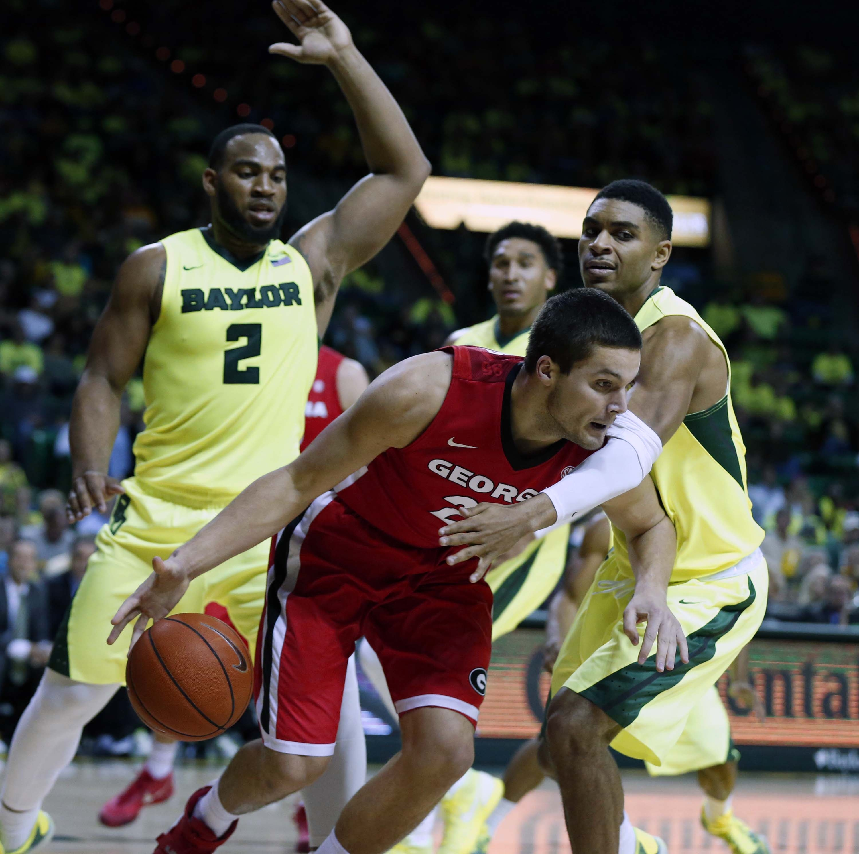 Georgia forward Houston Kessler (24) is pressured by Baylor guard Al Freeman (25), right, in the first half of an NCAA college basketball game, Saturday, Jan. 30, 2016, in Waco, Texas. Looking on is Baylor forward Rico Gathers (2). (Rod Aydelotte/Waco Tri