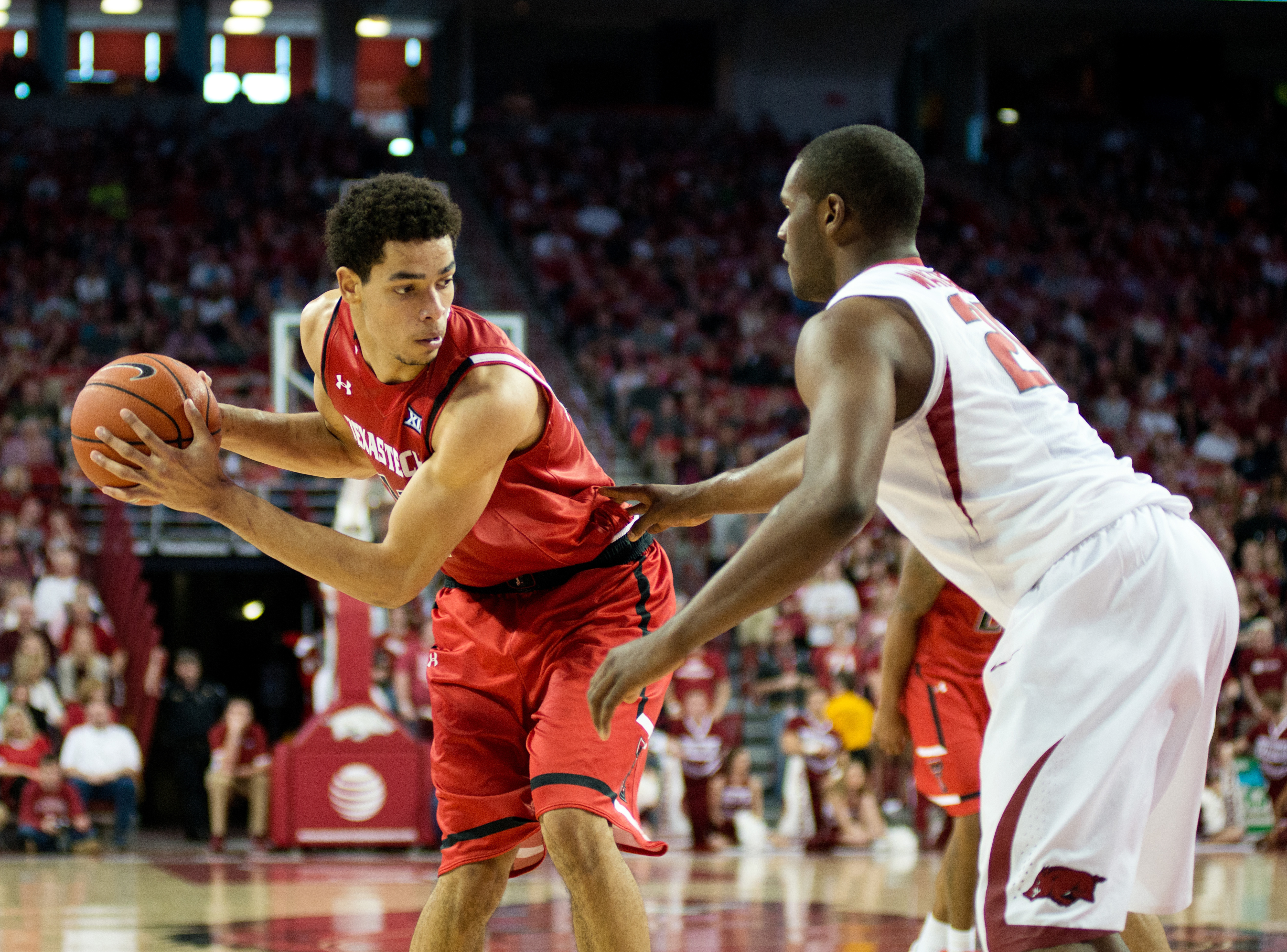 Arkansas' Manuale Watkins (21) defends Texas Tech's Zach Smith (11) in the second half of an NCAA college basketball game in Fayetteville, Ark., Saturday, Jan. 30, 2016. Arkansas won 75-68. (AP Photo/Sarah Bentham)