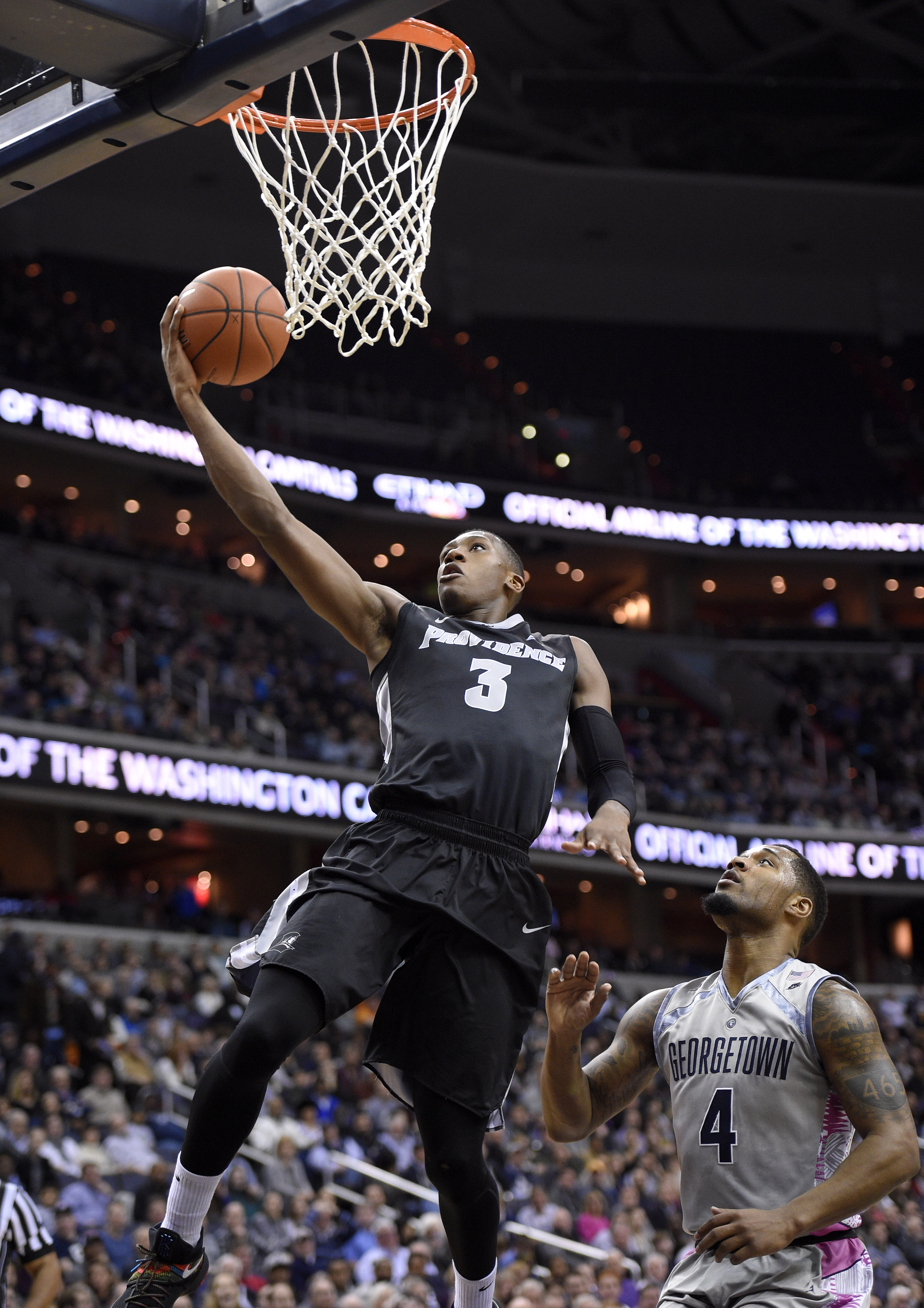 Providence guard Kris Dunn (3) goes to the basket past Georgetown guard D'Vauntes Smith-Rivera (4) during the first half of an NCAA college basketball game, Saturday, Jan. 30, 2016, in Washington. (AP Photo/Nick Wass)