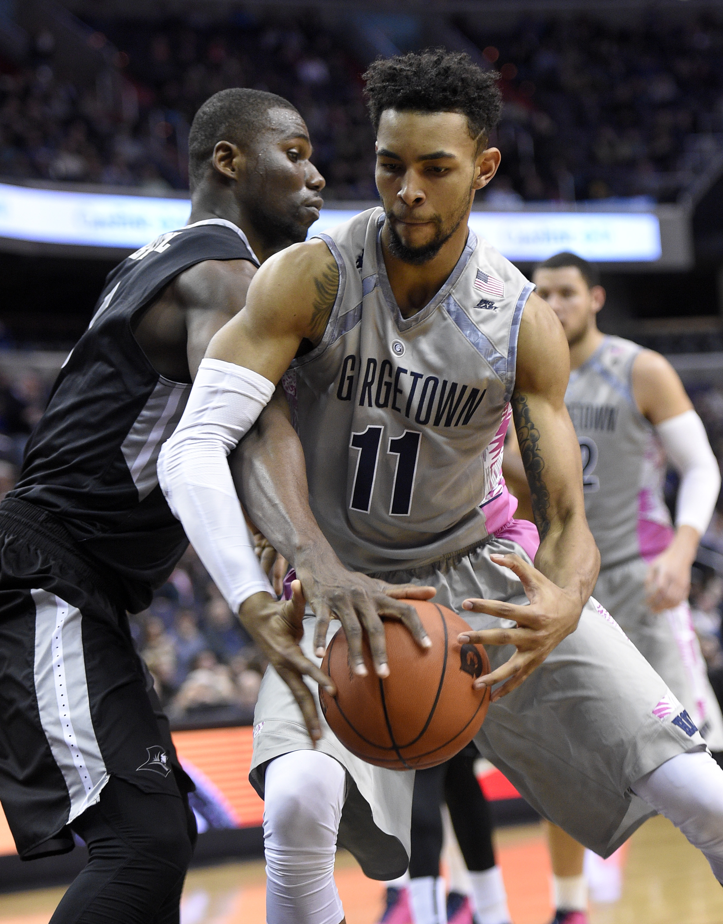 Providence forward Ben Bentil, left, reaches for the ball against Georgetown forward Isaac Copeland (11) during the second half of an NCAA college basketball game Saturday, Jan. 30, 2016, in Washington. Providence won 73-69. (AP Photo/Nick Wass)