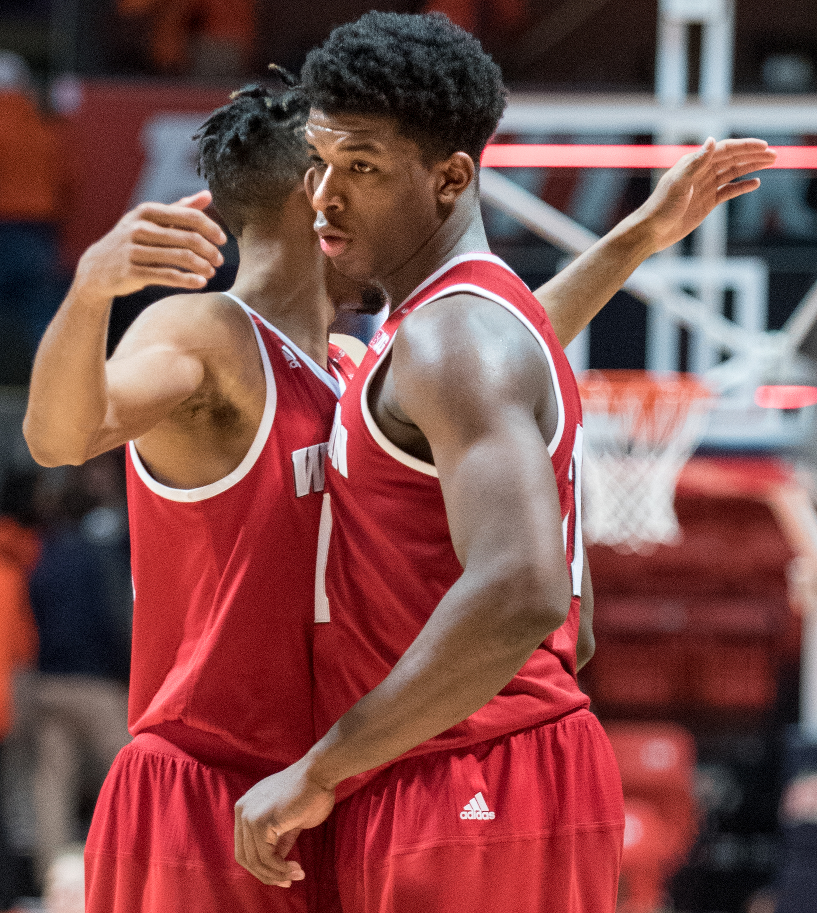 Wisconsin's forward Khalil Iverson (21) is chest bumped by teammate Wisconsin's guard Jordan Hill (11) following an NCAA college basketball game in Champaign, Ill., Sunday, Jan. 31, 2016. Wisconsin won 63-55. (AP Photo/Robin Scholz)