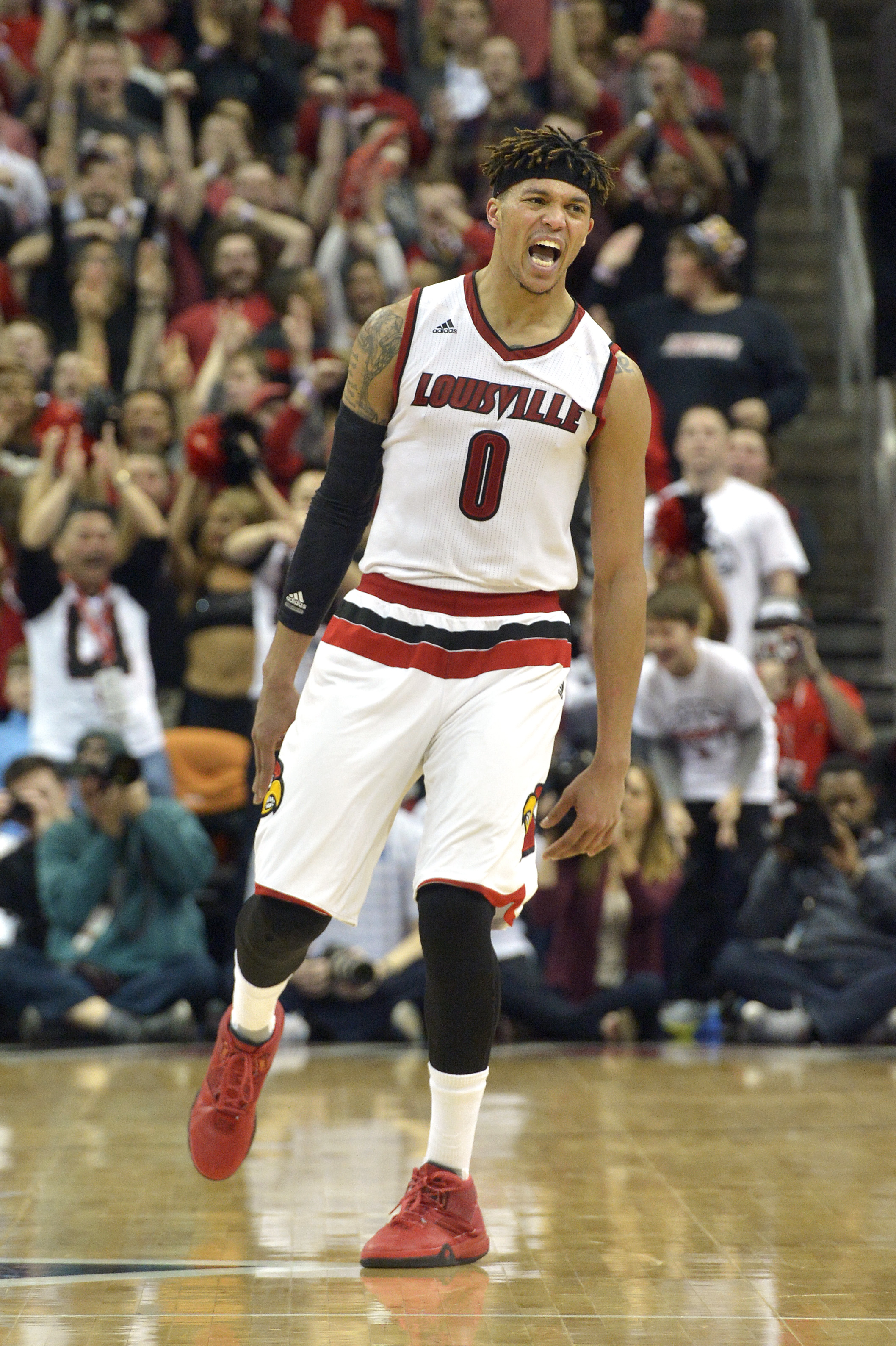 Louisville's Damion Lee reacts following a three-point basket during the second half of an NCAA college basketball game against North Carolina, Monday, Feb. 1, 2016, in Louisville, Ky. Louisville won 71-65. (AP Photo/Timothy D. Easley)