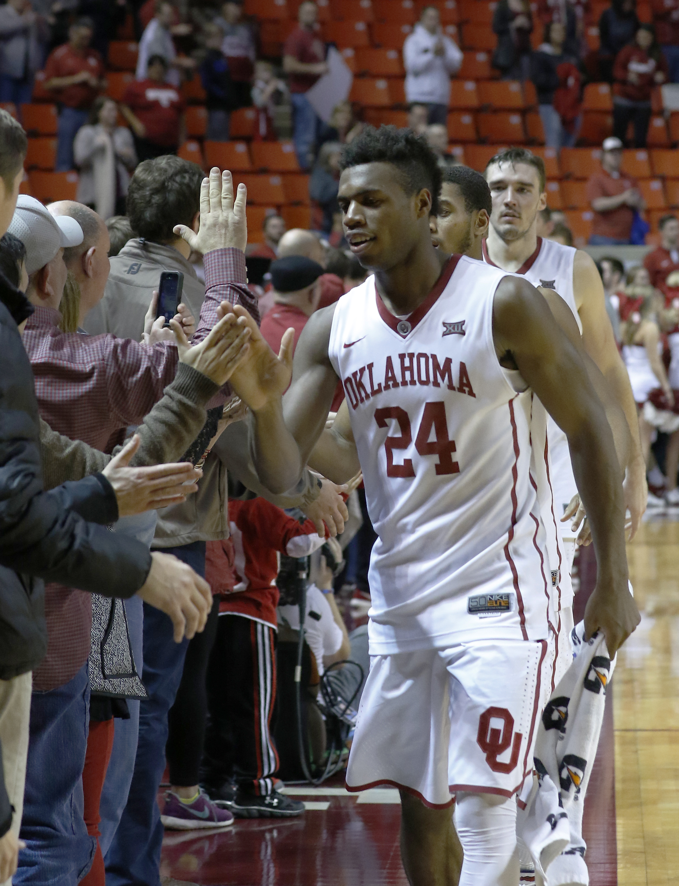 Oklahoma guard Buddy Hield (24) high fives fans after Oklahoma defeated TCU during an NCAA college basketball game in Norman, Okla., Tuesday, Feb. 2, 2016. Oklahoma won 95-72. (AP Photo/Alonzo Adams)