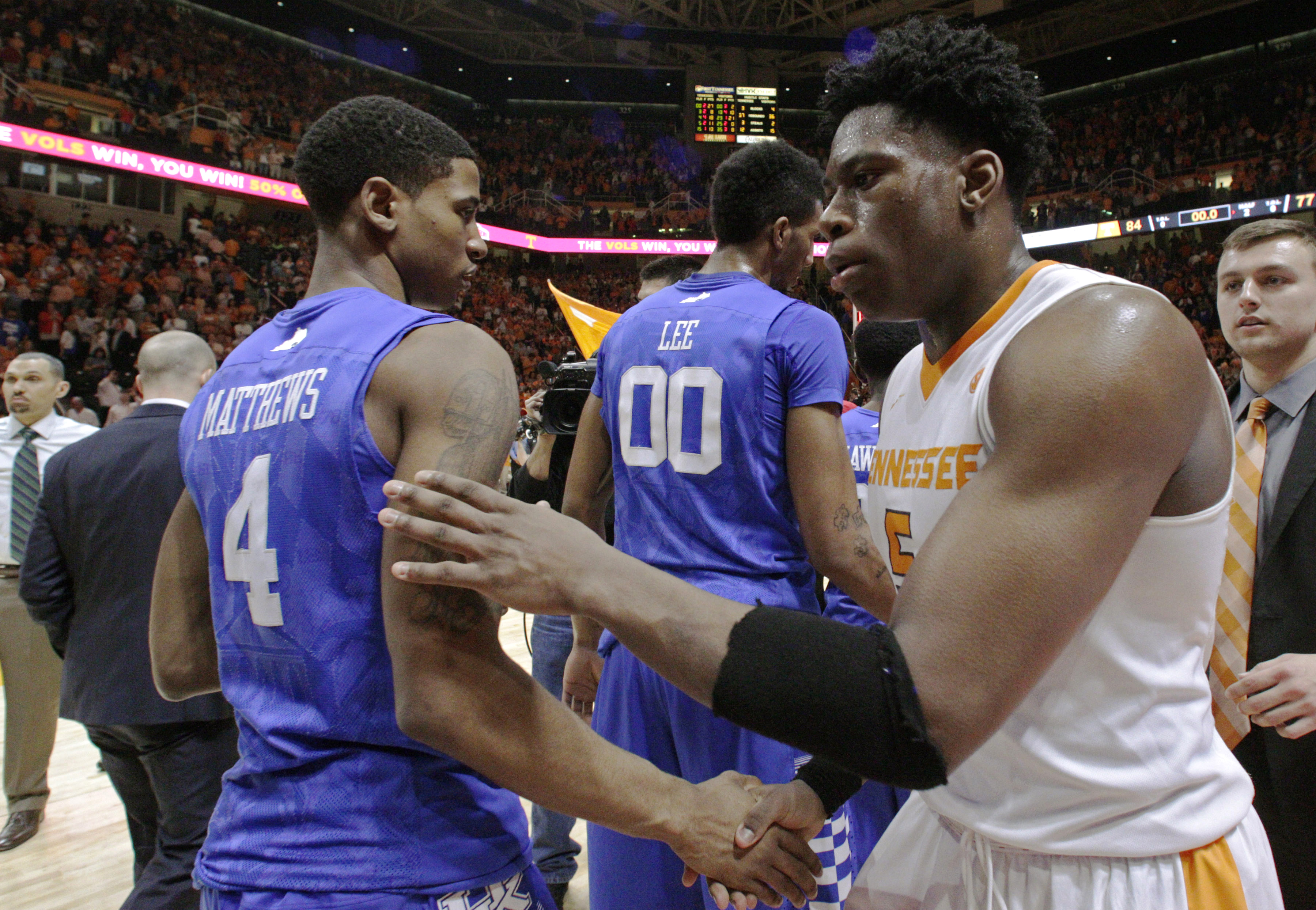 Tennessee forward Admiral Schofield (5) shakes hands with Kentucky guard Charles Matthews (4) after an NCAA college basketball game Tuesday, Feb. 2, 2016, in Knoxville, Tenn. Tennessee won 84-77. (AP Photo/Wade Payne)