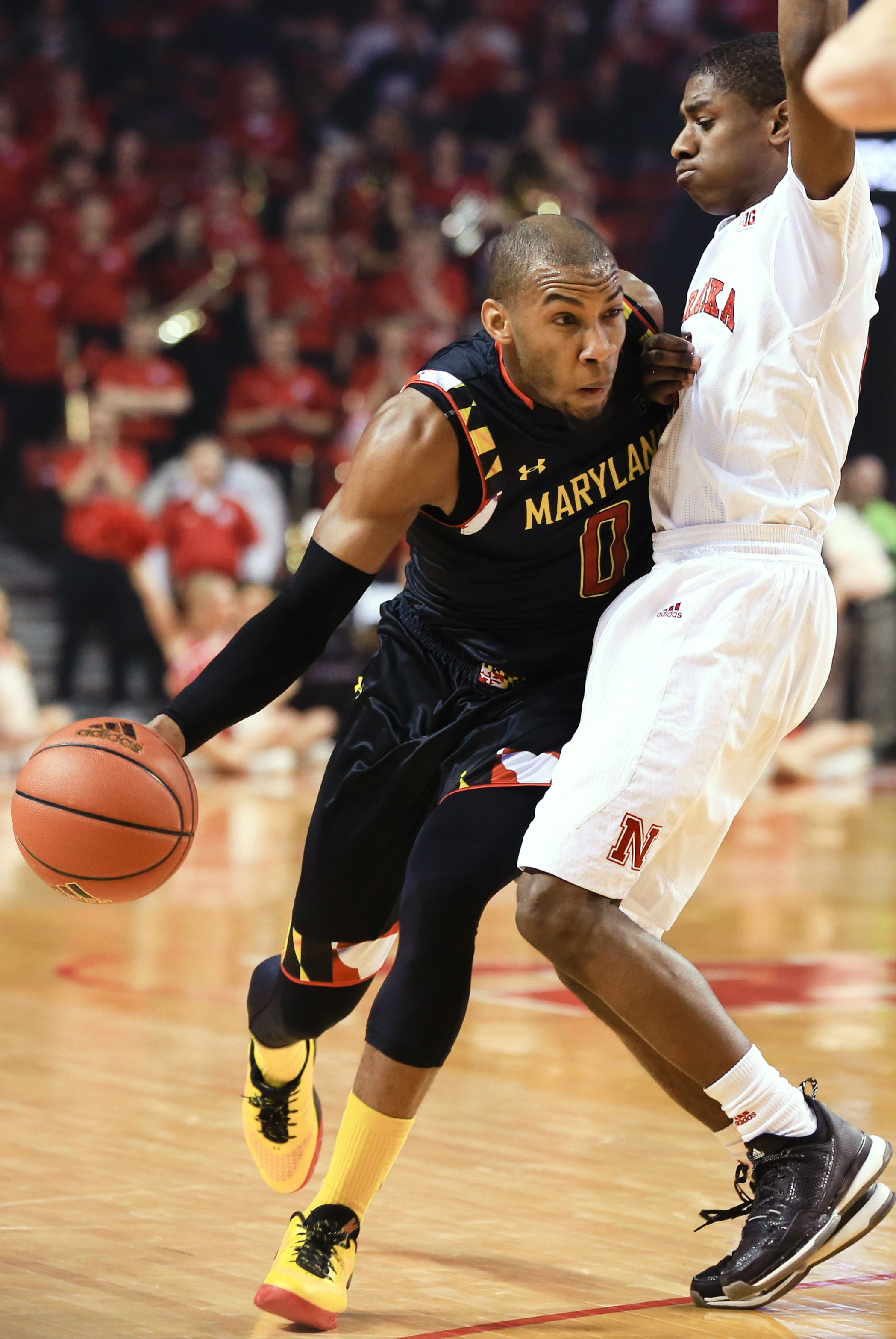 Maryland's Rasheed Sulaimon (0) drives around Nebraska's Glynn Watson Jr. (5) during the first half of an NCAA college basketball game in Lincoln, Neb., Wednesday, Feb. 3, 2016. (AP Photo/Nati Harnik)