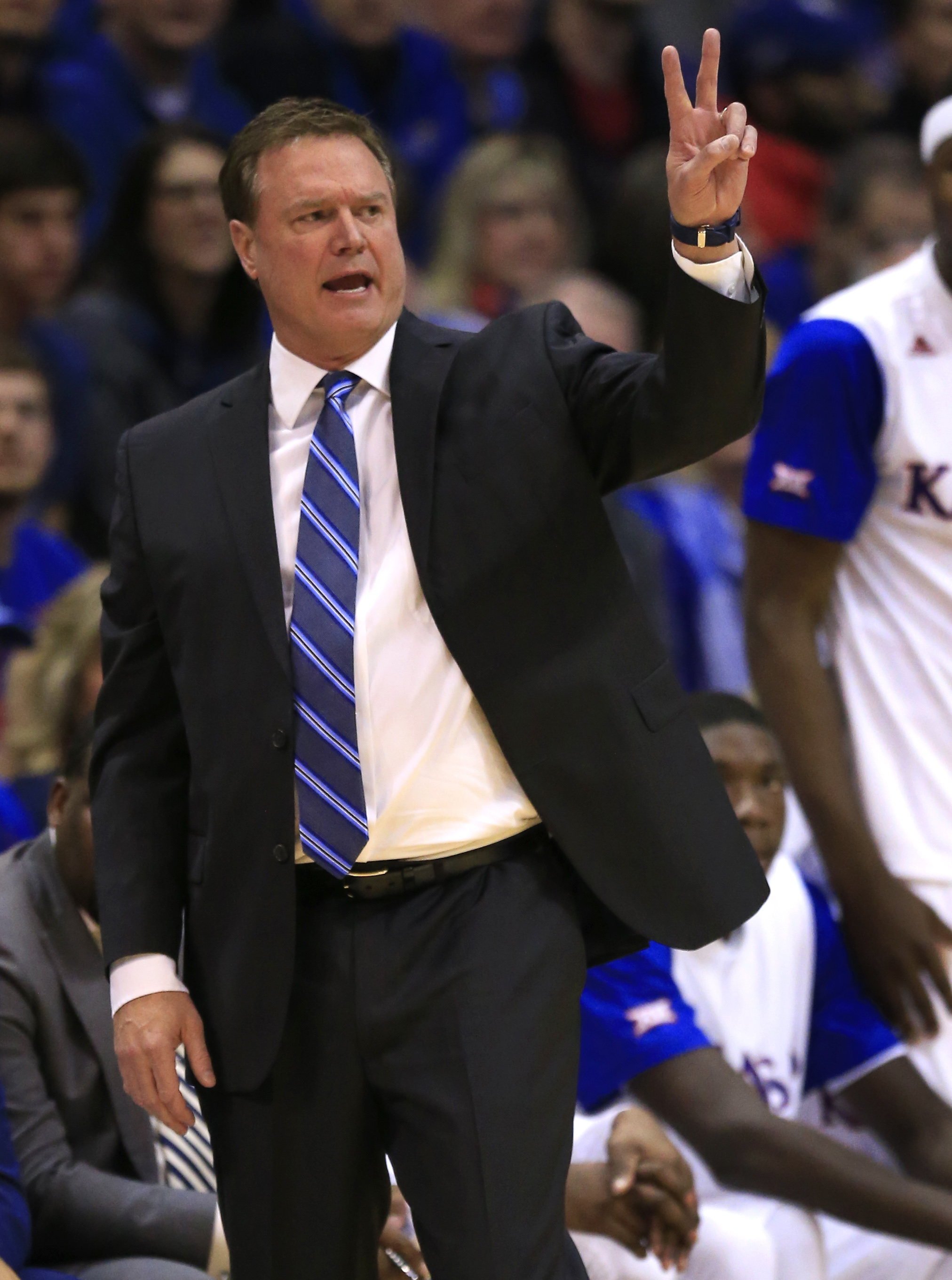Kansas head coach Bill Self calls a play during the first half of an NCAA college basketball game against Kansas State in Lawrence, Kan., Wednesday, Feb. 3, 2016. (AP Photo/Orlin Wagner)