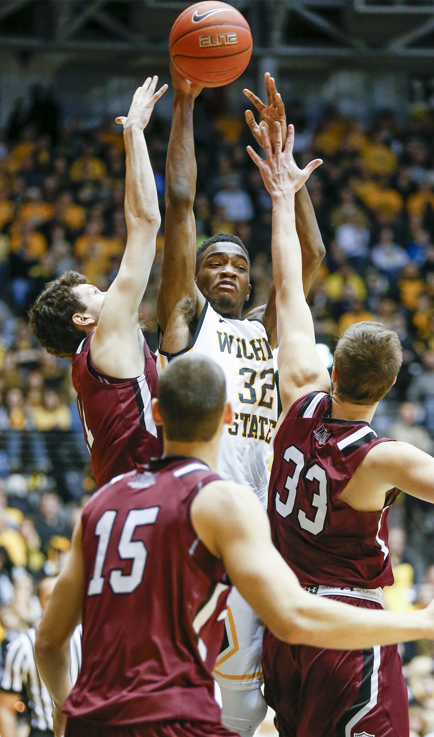 Wichita State's Markis McDuffie (32) dishes off against Southern Illinois during an NCAA college basketball game Wednesday, Feb. 3, 2016, in Wichita, Kan. (Fernando Salazar/The Wichita Eagle via AP)