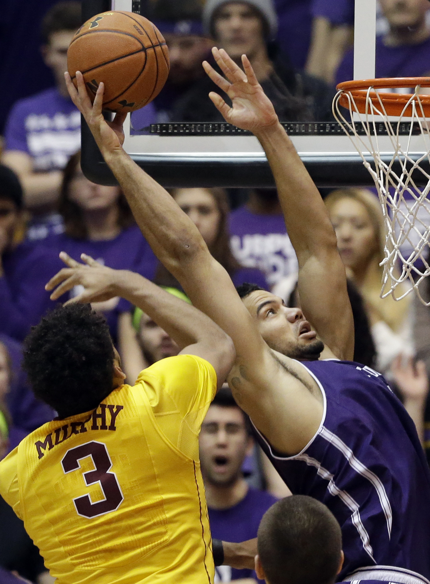 Northwestern center Joey van Zegeren, right, shoots past Minnesota forward Jordan Murphy during the first half of an NCAA college basketball game on Thursday, Feb. 4, 2016, in Evanston, Ill. (AP Photo/Nam Y. Huh)