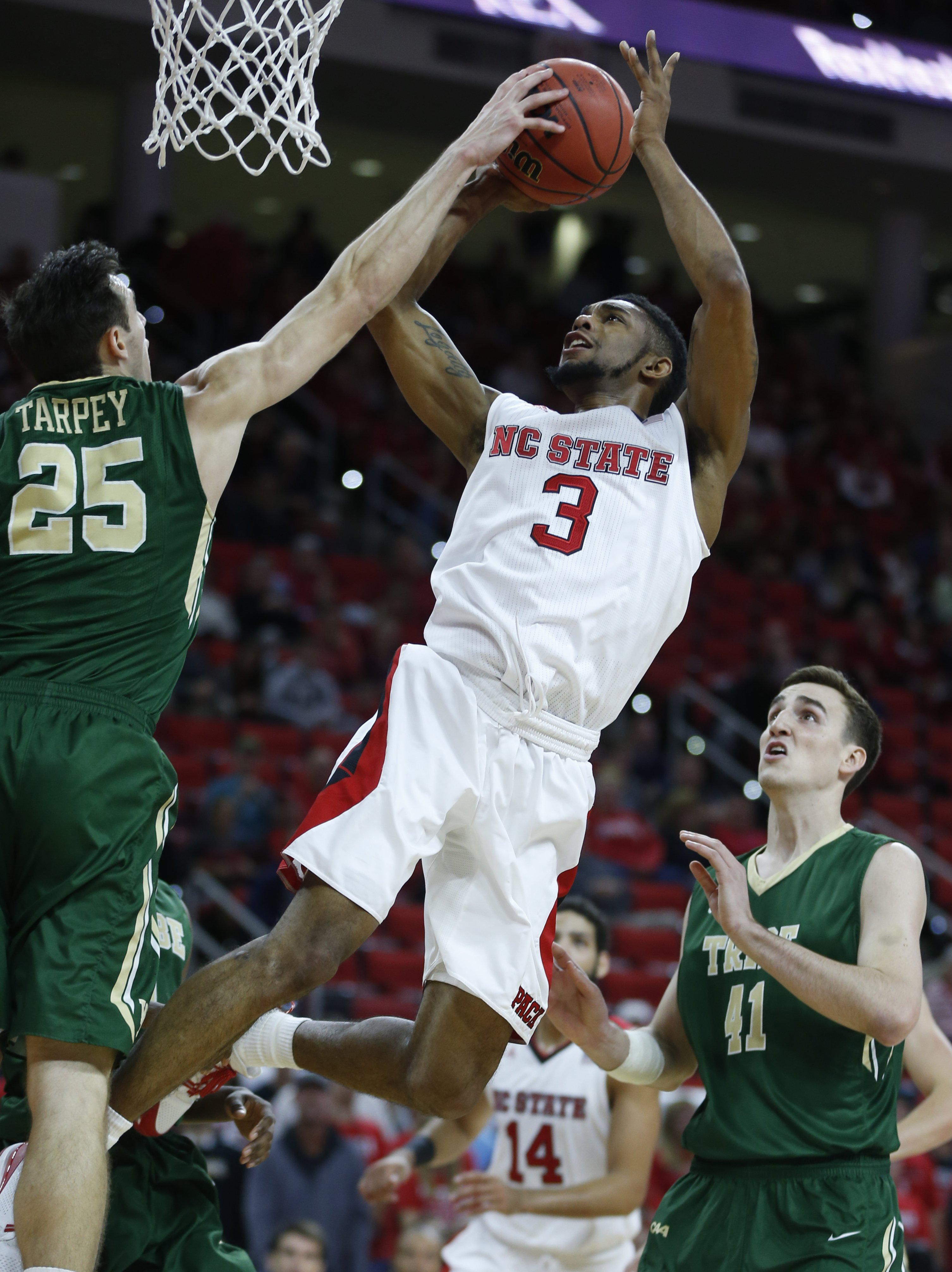 In this Nov. 13, 2015, photo, William & Mary's Terry Tarpey (25) blocks a shot by North Carolina State's Terry Henderson (3) during an NCAA college basketball game in Raleigh, N.C. Henderson played 7 minutes against William & Mary before tearing ligaments