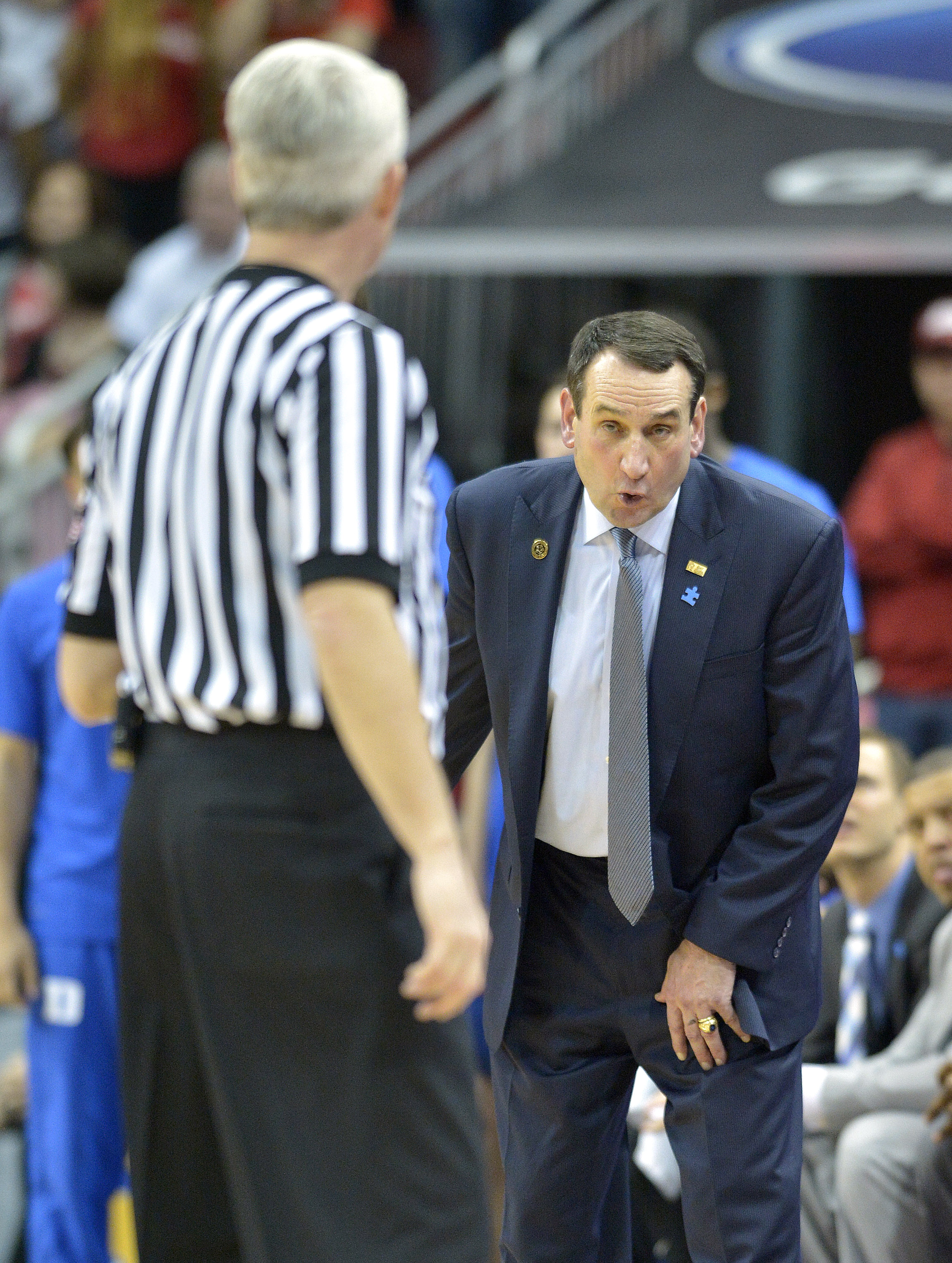 Duke head coach Mike Krzyzewski argues with game official Brian O'Connell during the second half of an NCAA college basketball game against Louisville, Saturday, Feb. 20, 2016 in Louisville Ky. Louisville won 71-64. (AP Photo/Timothy D. Easley)