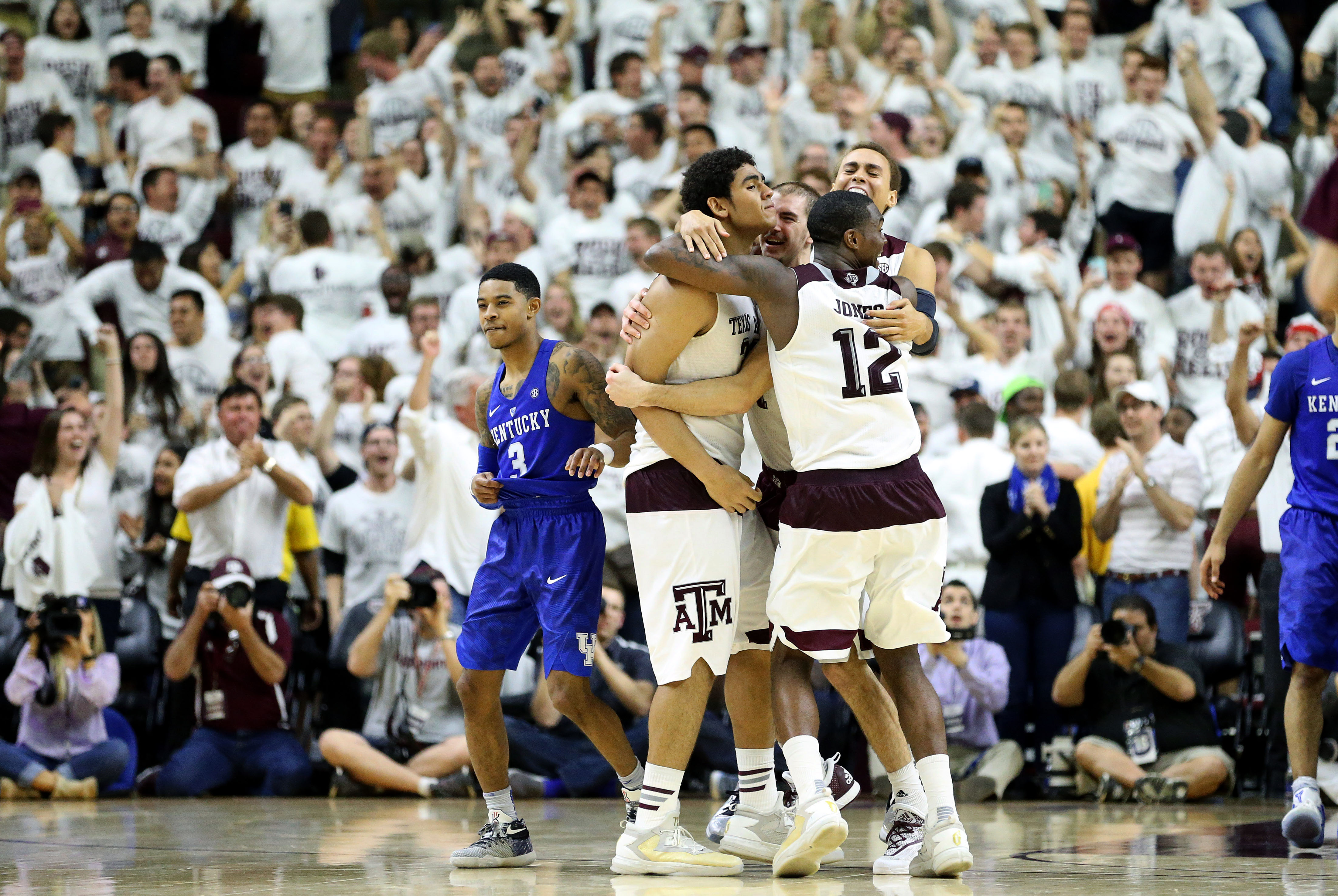 Texas A&M's Tyler Davis (23) celebrates his game winning shot with teammates during overtime of an NCAA college basketball game against Kentucky, Saturday, Feb. 20, 2016, in College Station, Texas. Texas A&M won 79-77. (AP Photo/Sam Craft)