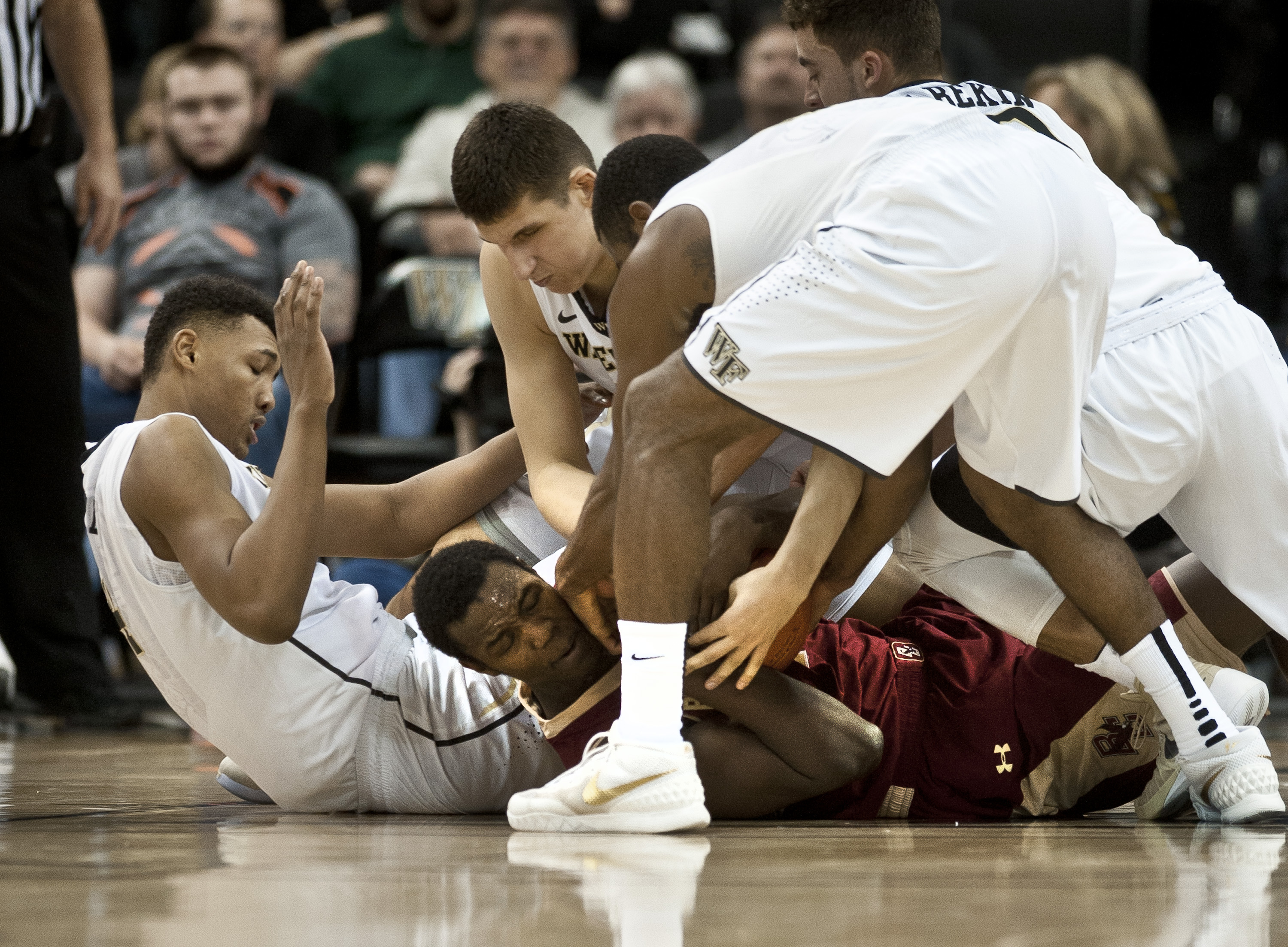 Wake Forest's from left Doral Moore, Konstantinos Mitoglou and Codi Miller-McIntyre battle for the ball with Boston College's Idy Diallo  during an NCAA college basketball game Sunday Feb. 21, 2016, in Winston-Salem, N.C. (Walt Unks/The Winston-Salem Jour