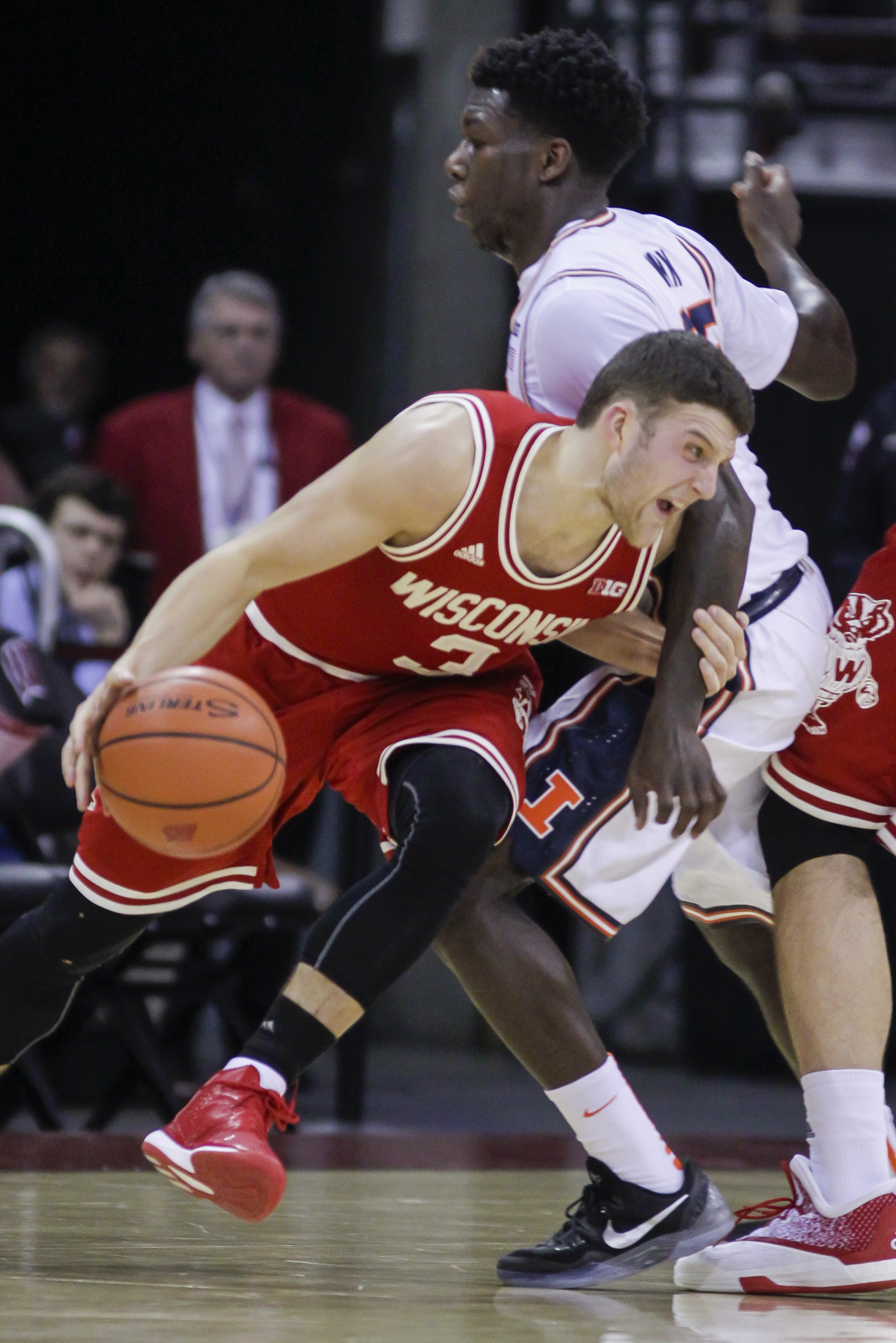 Wisconsin's Zak Showalter (3) drives on Illinois' Kendrick Nunn (25) during the first half of an NCAA college basketball game Sunday, Feb. 21, 2016, in Madison, Wis. (AP Photo/Andy Manis)
